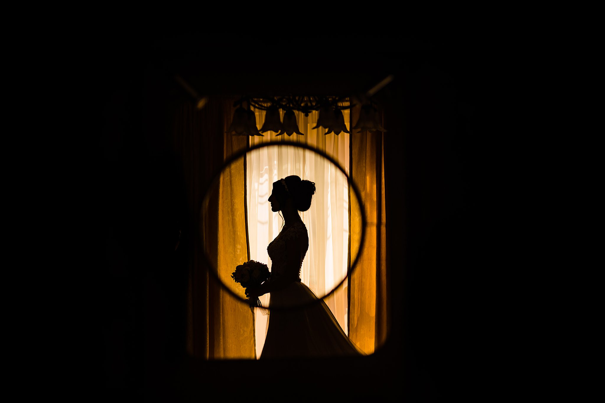 Silhouette of bride's profile with bouquet - photo by Shane P. Watts Photography