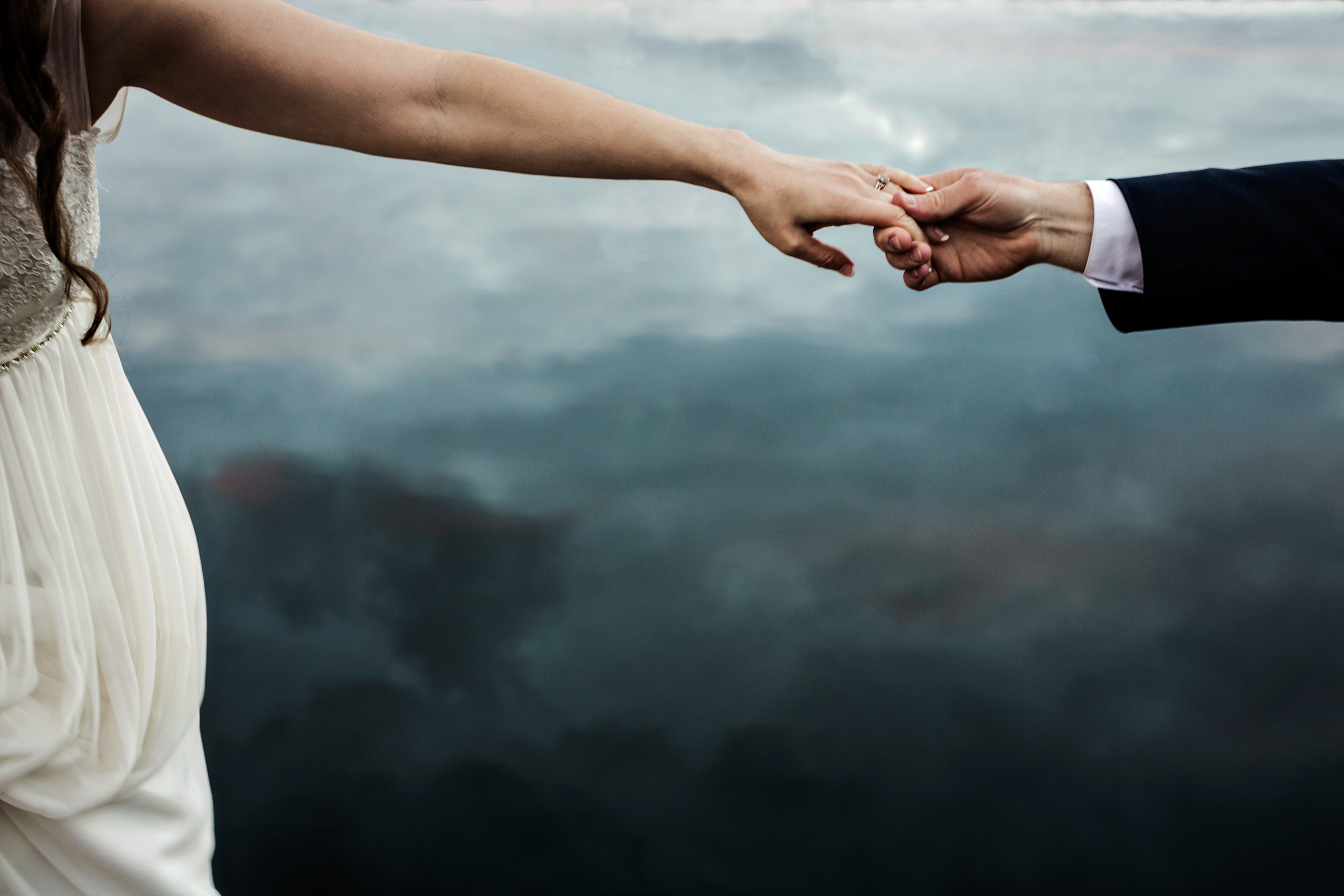 Detail of couple's hands - photo by JAGstudios