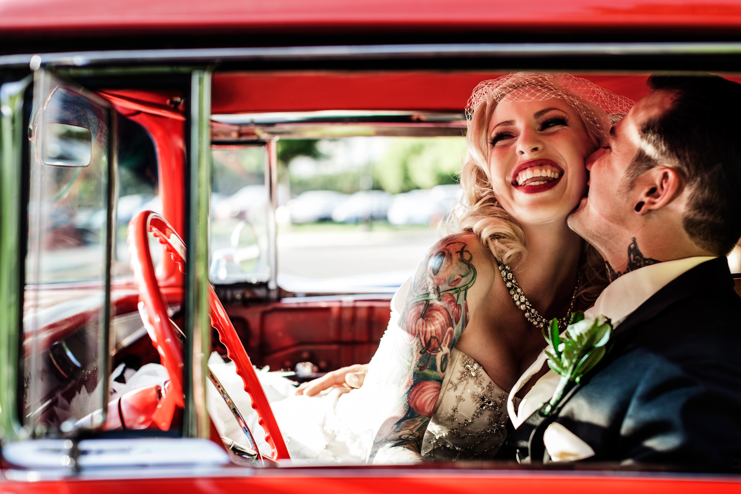 Tattoed bride laughing portrait - best wedding photo of the decade by JAGstudios