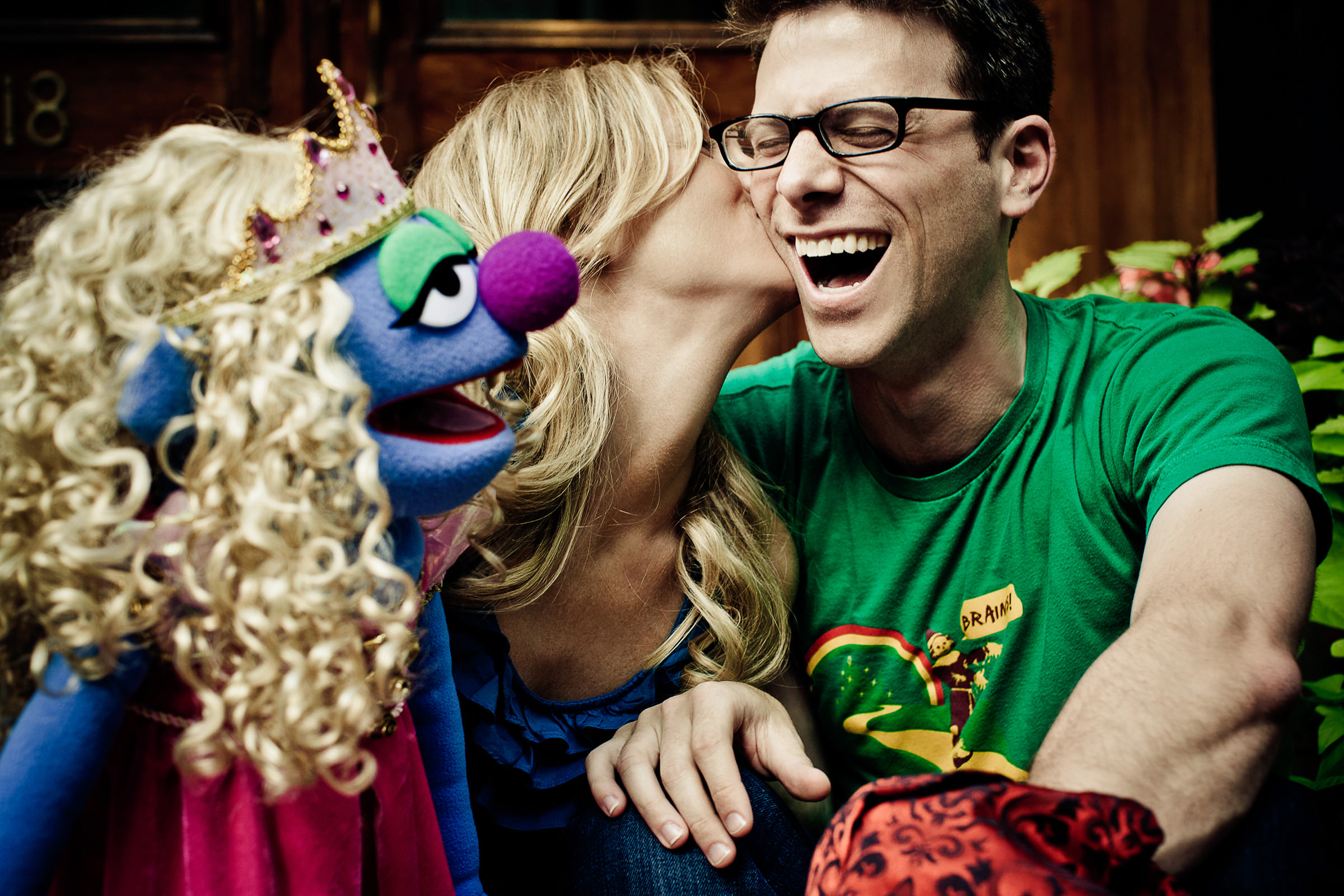 Cute couple laughing with muppet - photo by JAGstudios