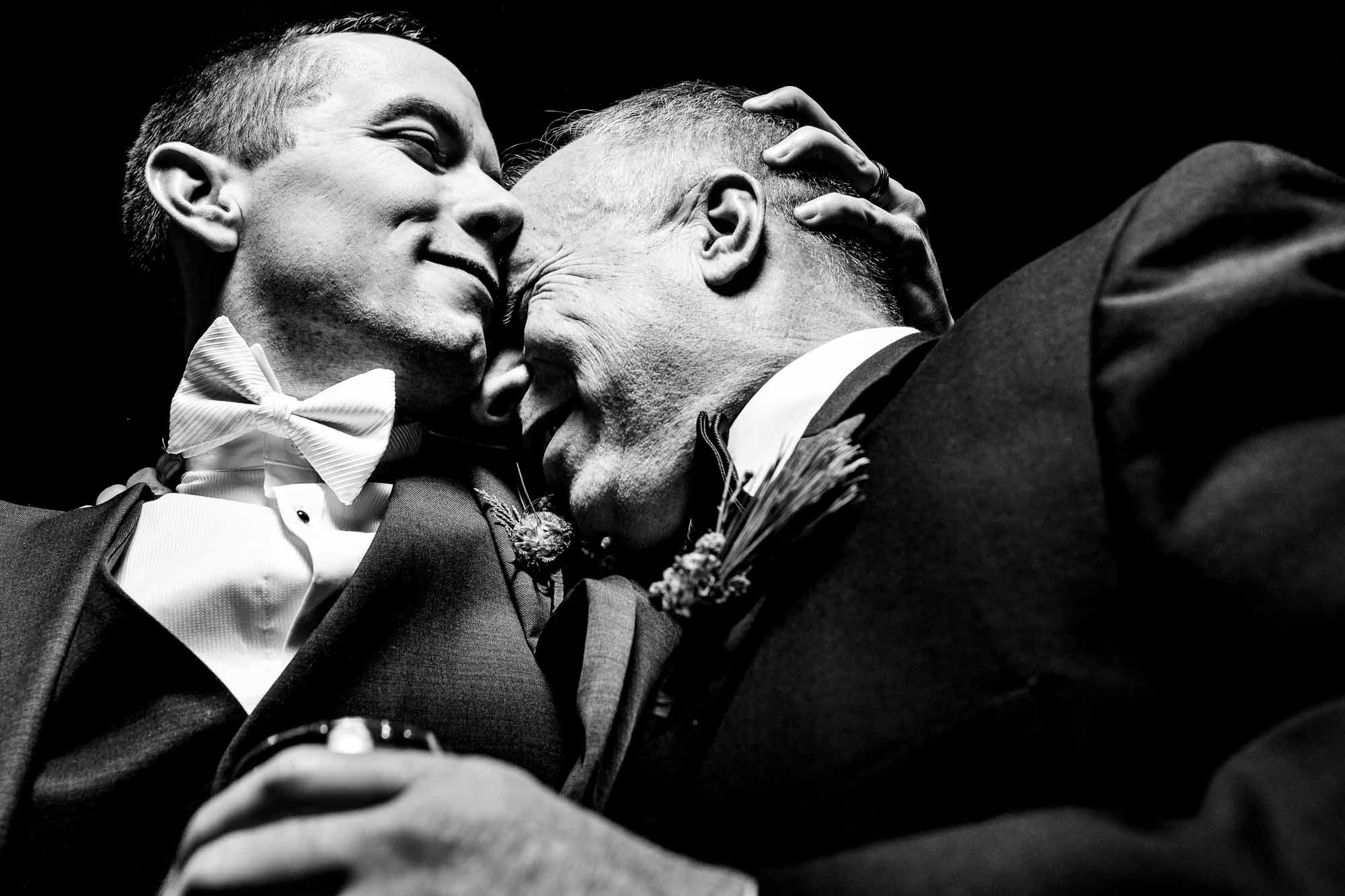 groom embraces father - photo by JOS & TREE