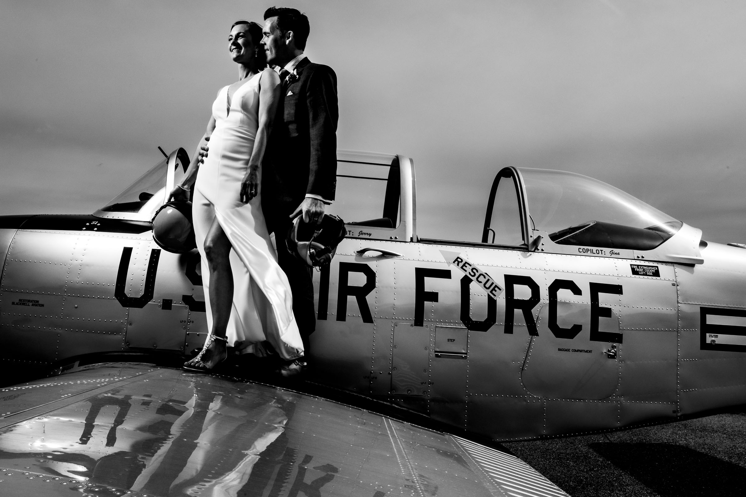Couple pose on wing of US Air Force plane - photo by JOS & TREE