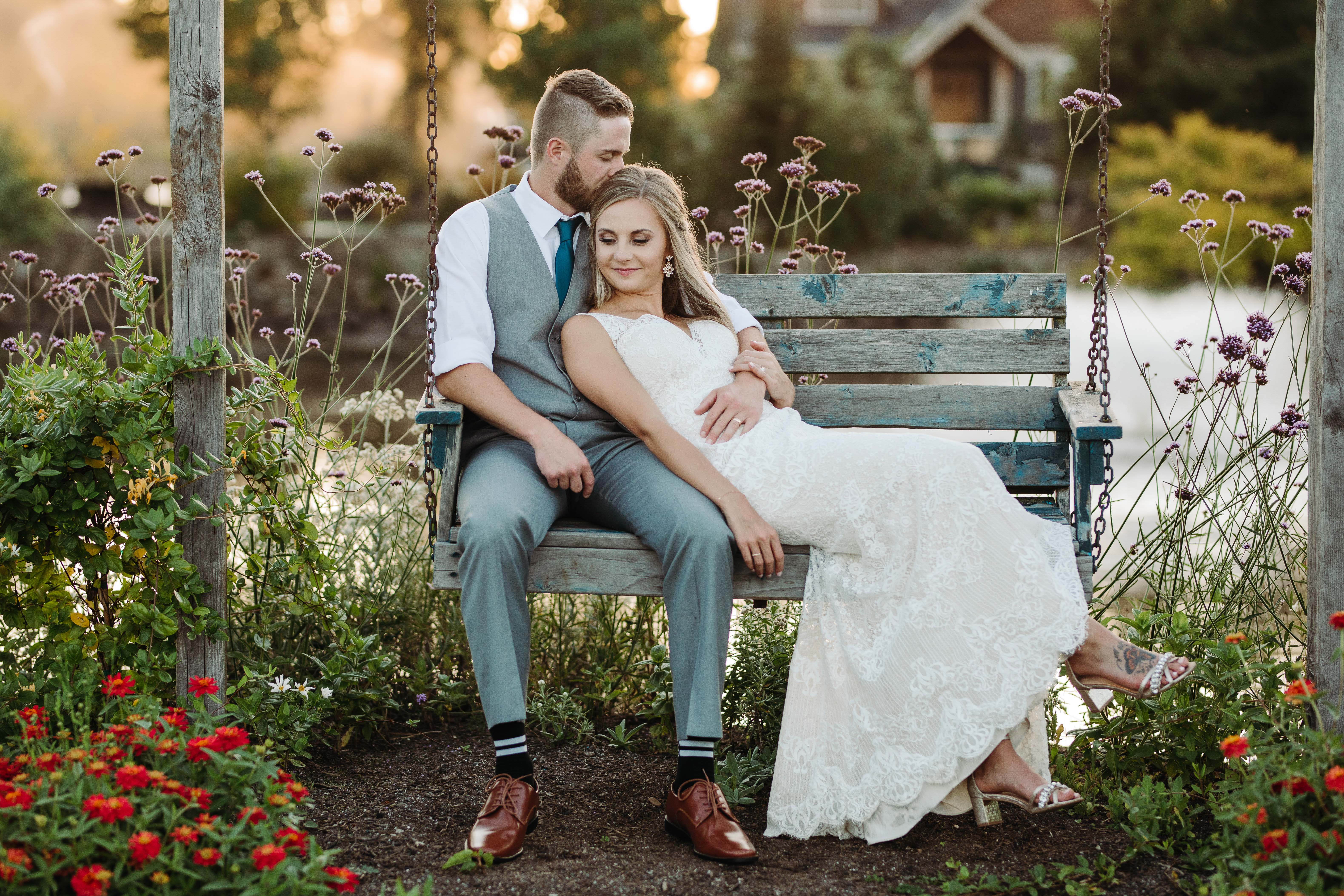 Bride and groom chilling on a swing - photo by Cameron Zegers Photography