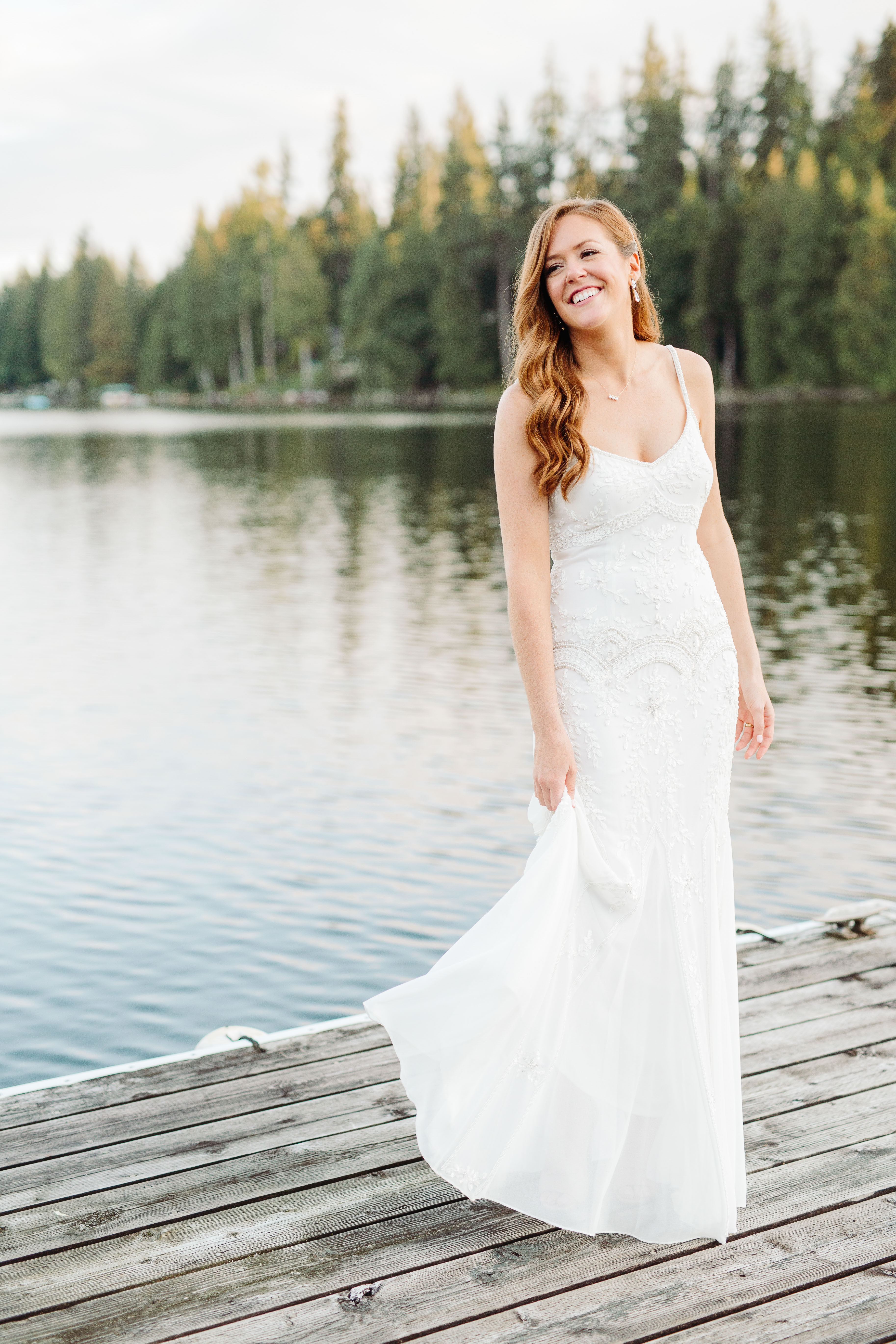 Bride at NW lake wearing spaghetti strap lace dress - photo by Cameron Zegers Photography
