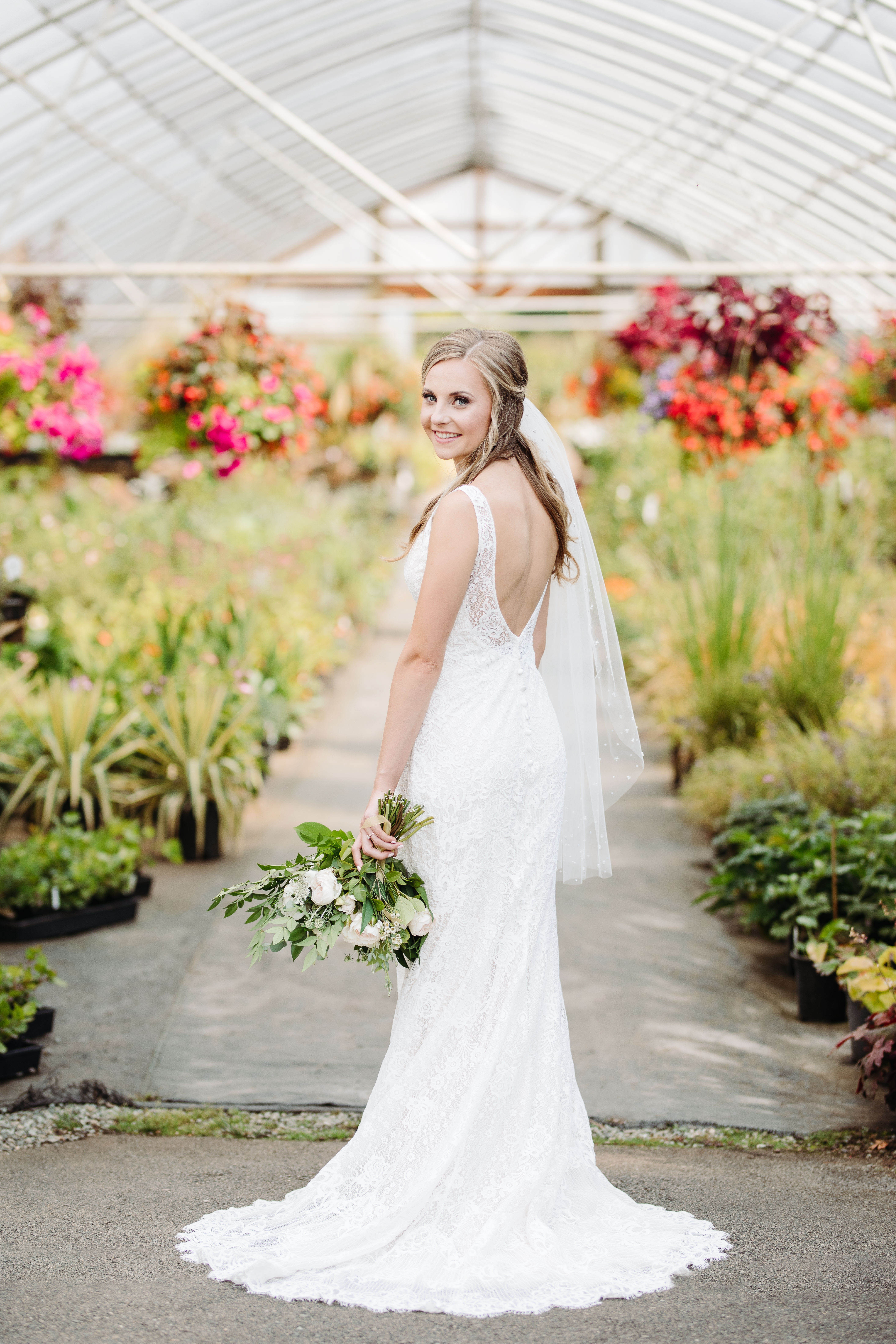 Bride with lace backless dress and veil - photo by Cameron Zegers Photography