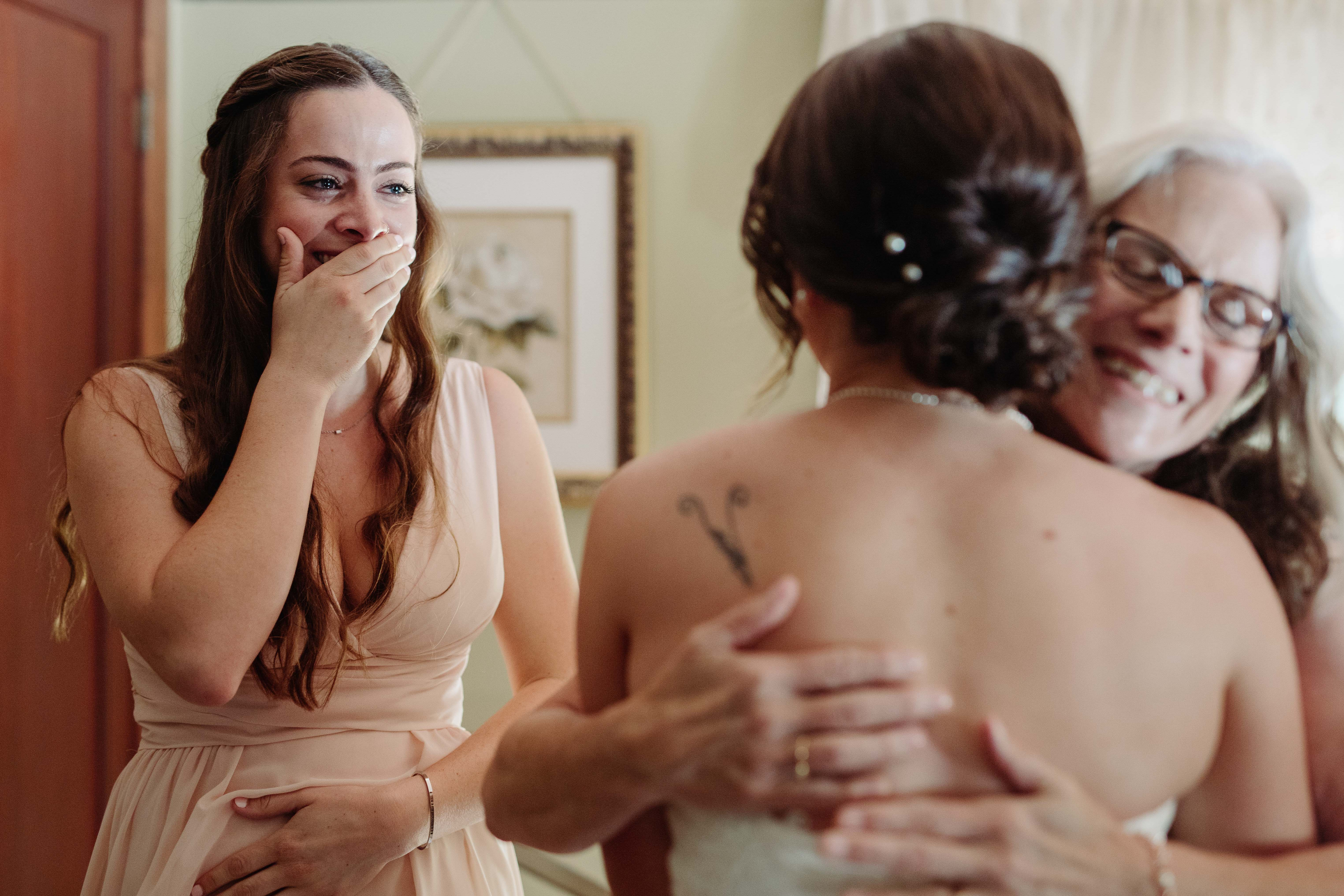 Bridesmaid tearing up during hug - photo by Cameron Zegers Photography