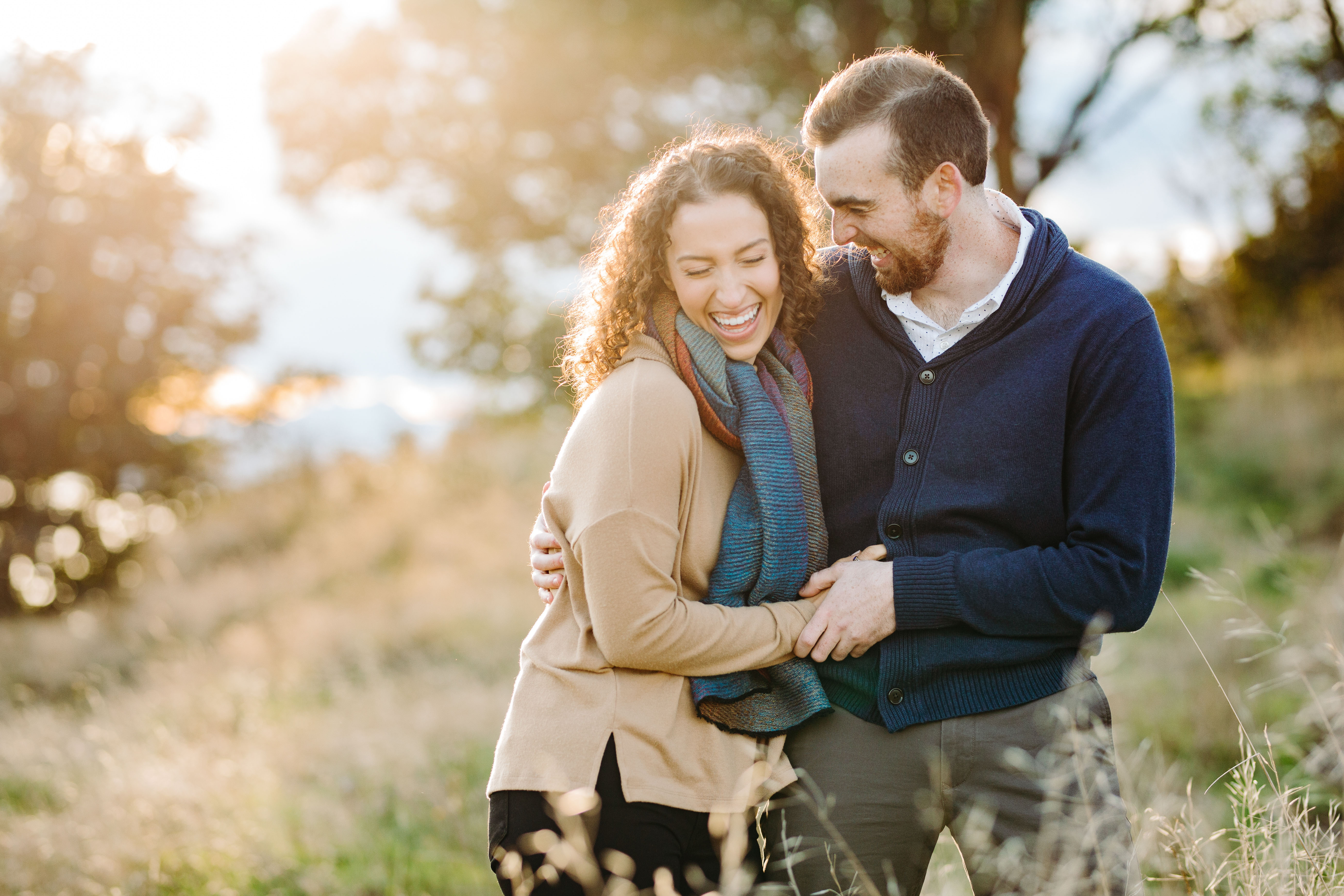 Fall engagement photo of laughing couple - photo by Cameron Zegers Photography