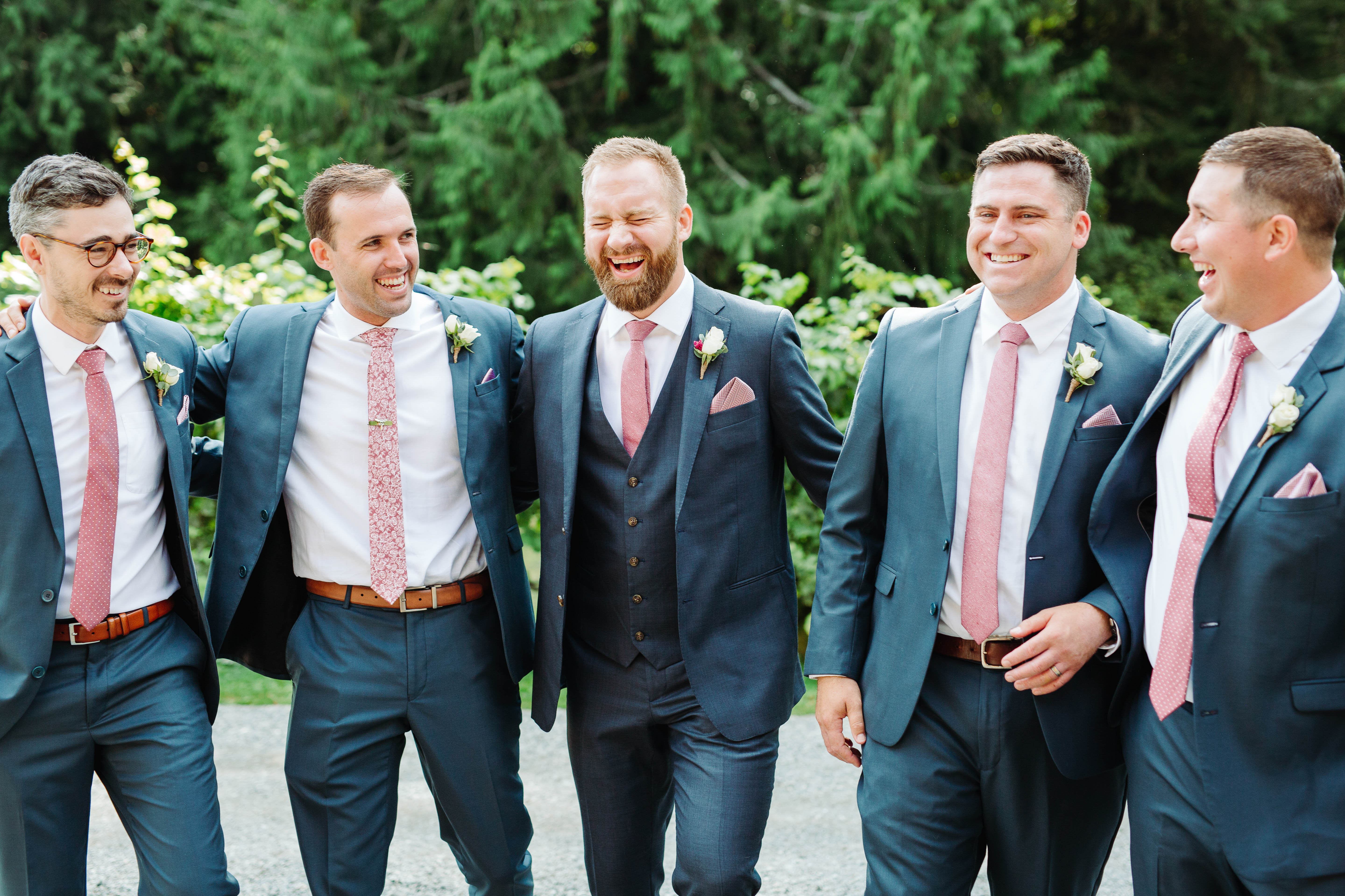 Groom and groomsmen in blue suits and pink ties - photo by Cameron Zegers Photography