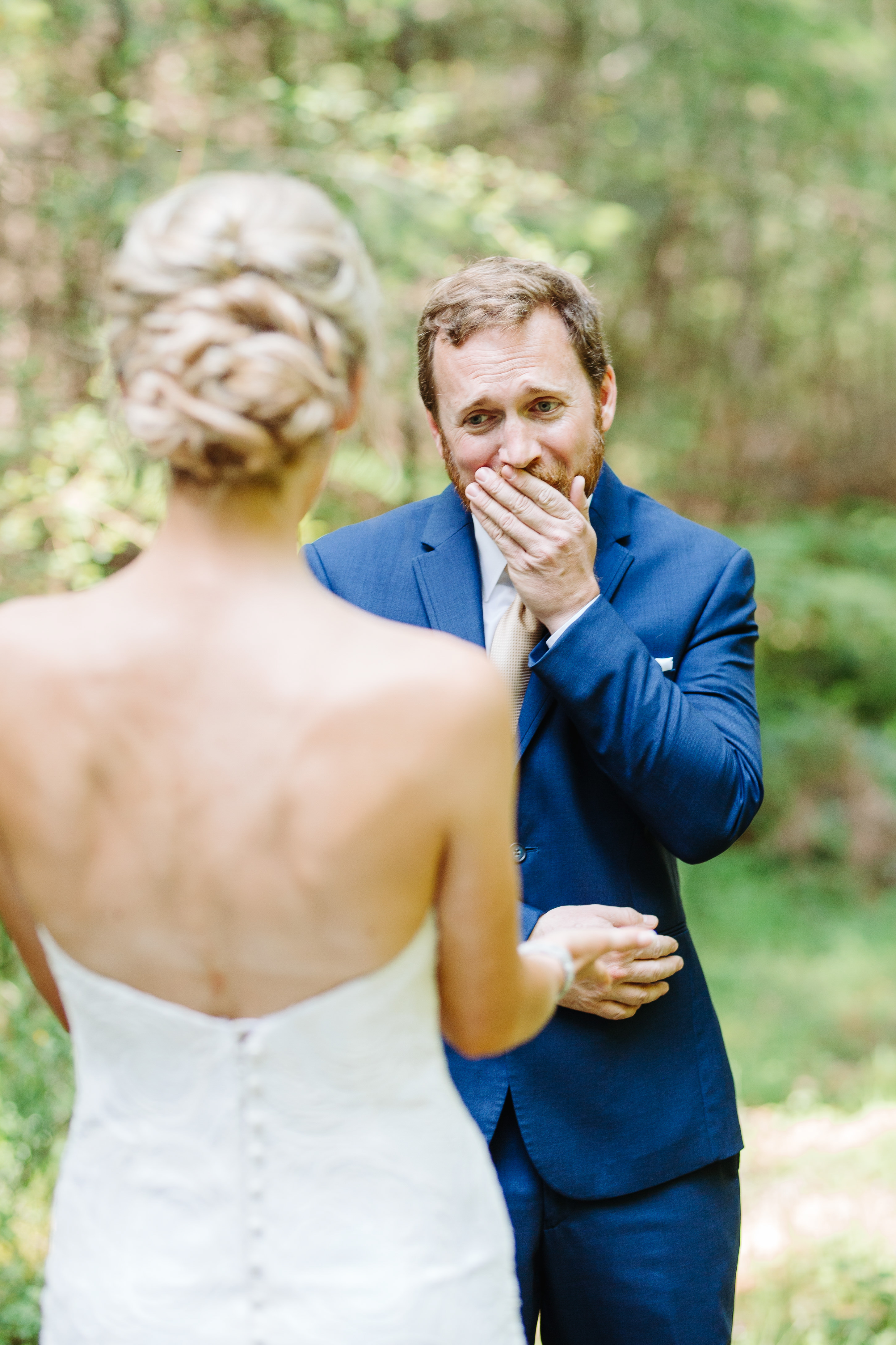 Groom reacts during first look - photo by Cameron Zegers Photography