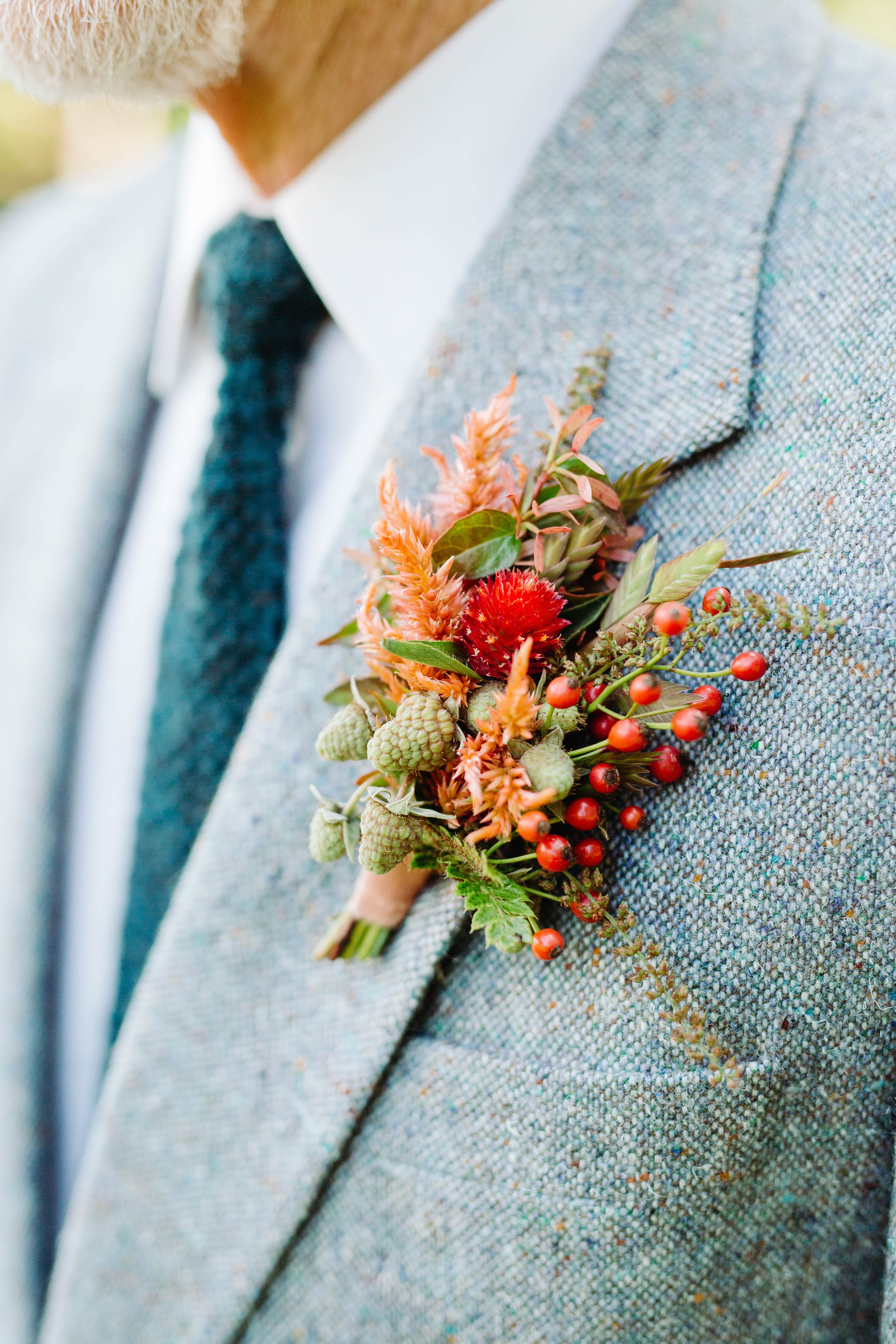 Late summer boutonniere with dried berries  - photo by Cameron Zegers Photography