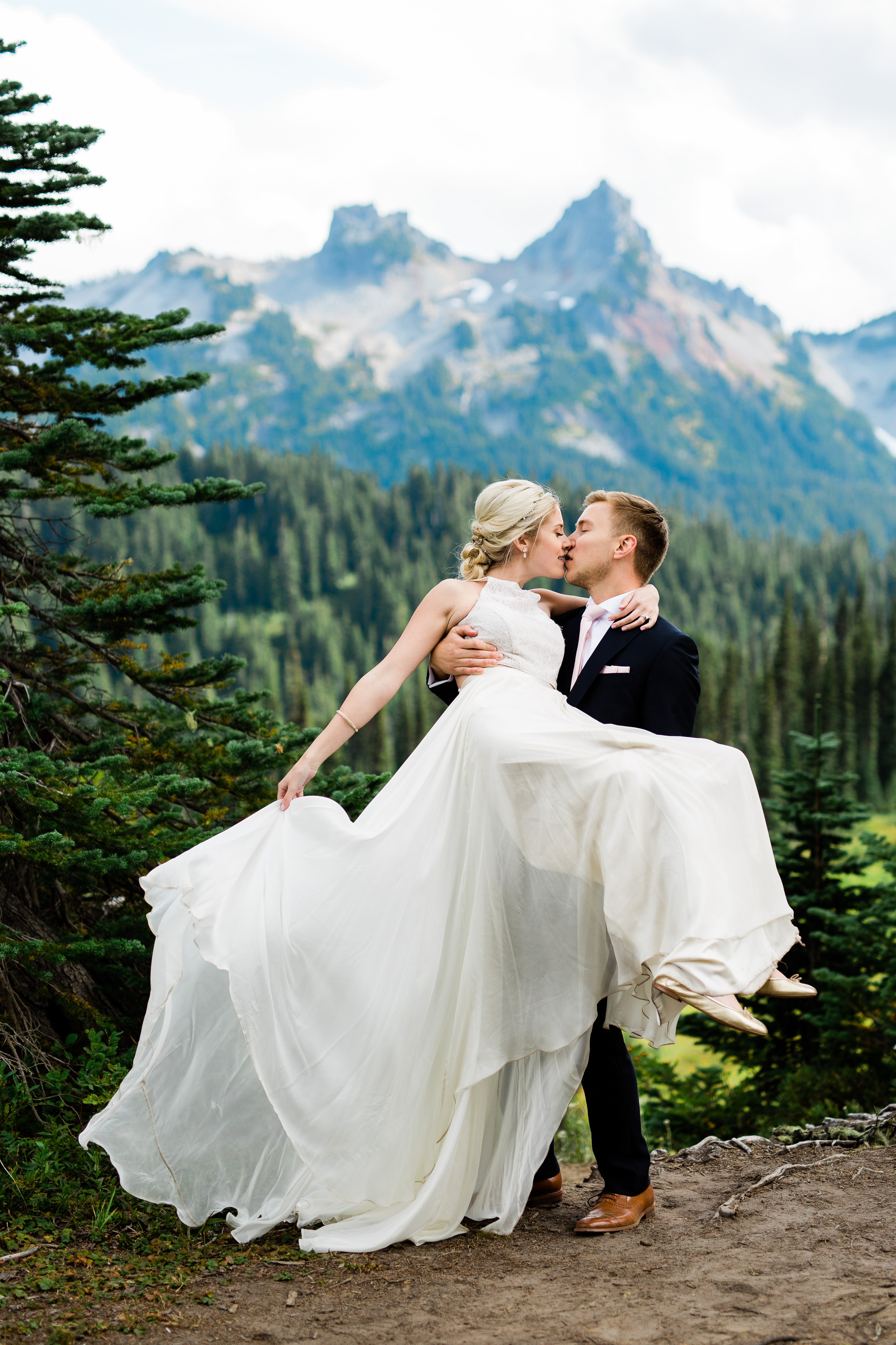 Romantic couple portrait with NW moutain background  by Cameron Zegers Photography