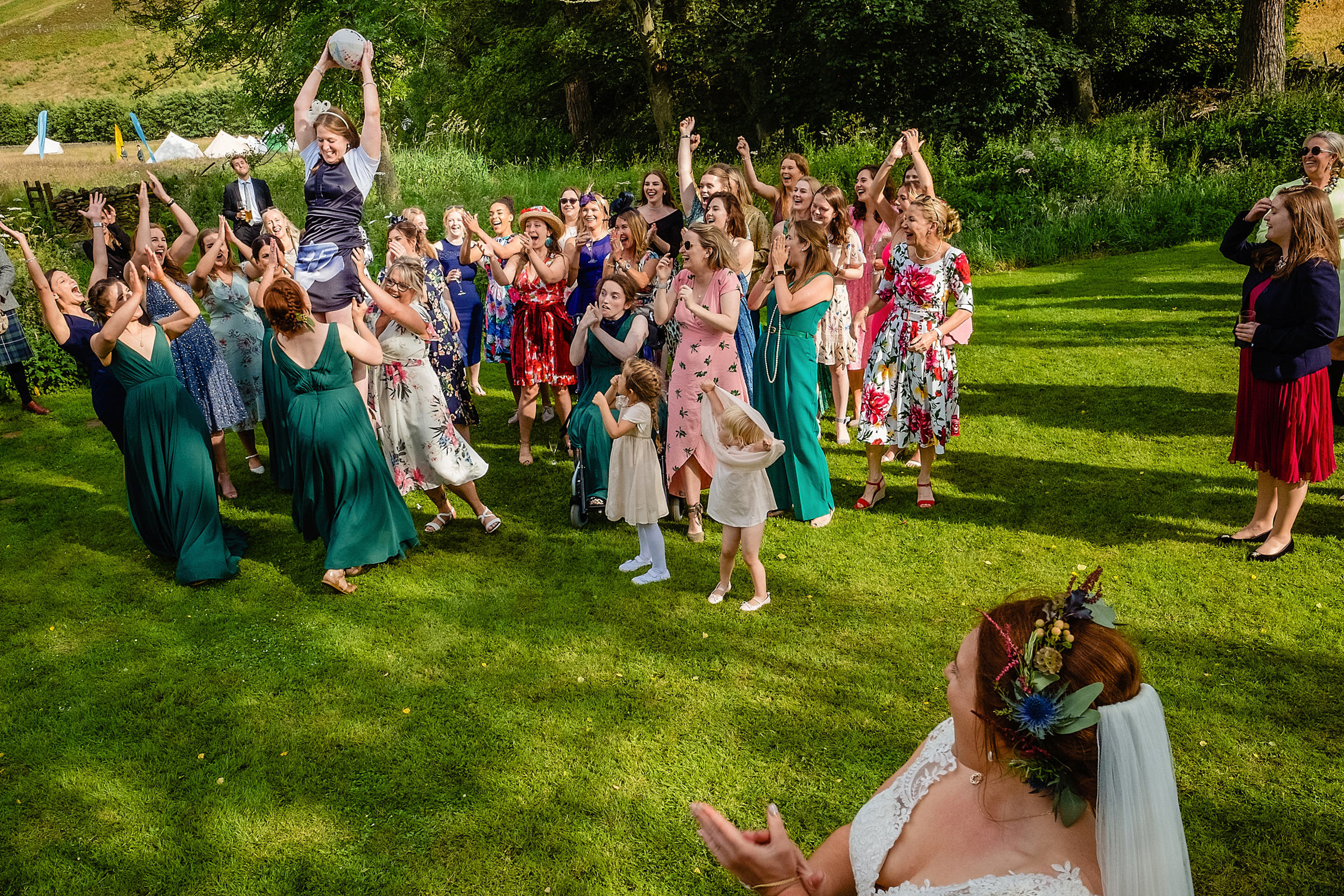 Bride and guests cheer on the aerial fun - photo by Emma + Rich