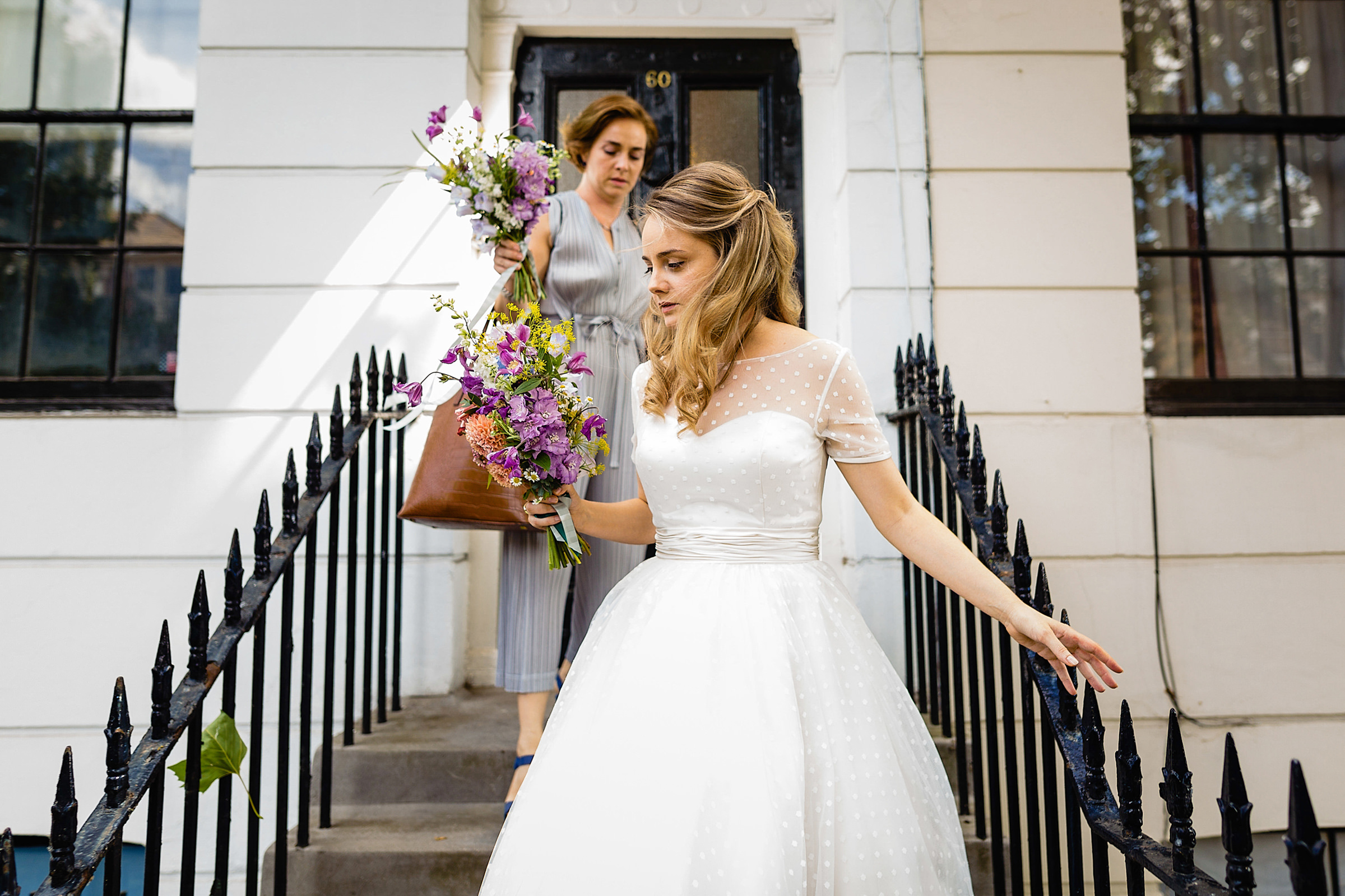 Bride and her mother carrying bouquets - photo by Emma + Rich