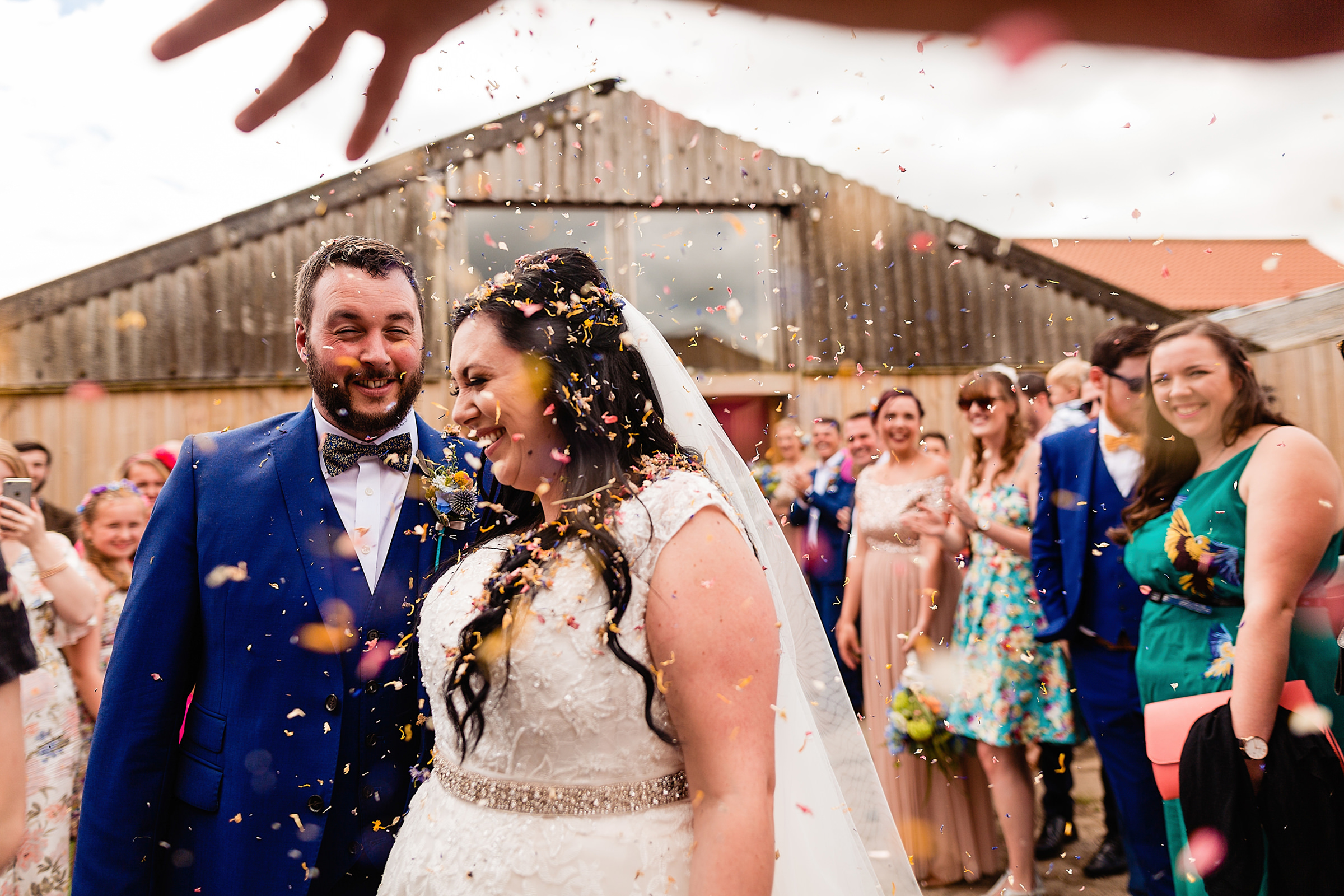 Creative composition of confetti recessional - photo by Emma + Rich