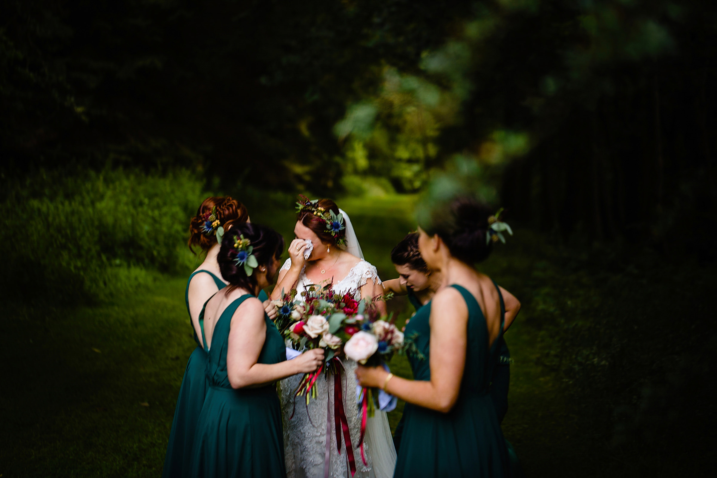 Emotional moment for bride with bridesmaids - photo by Emma + Rich
