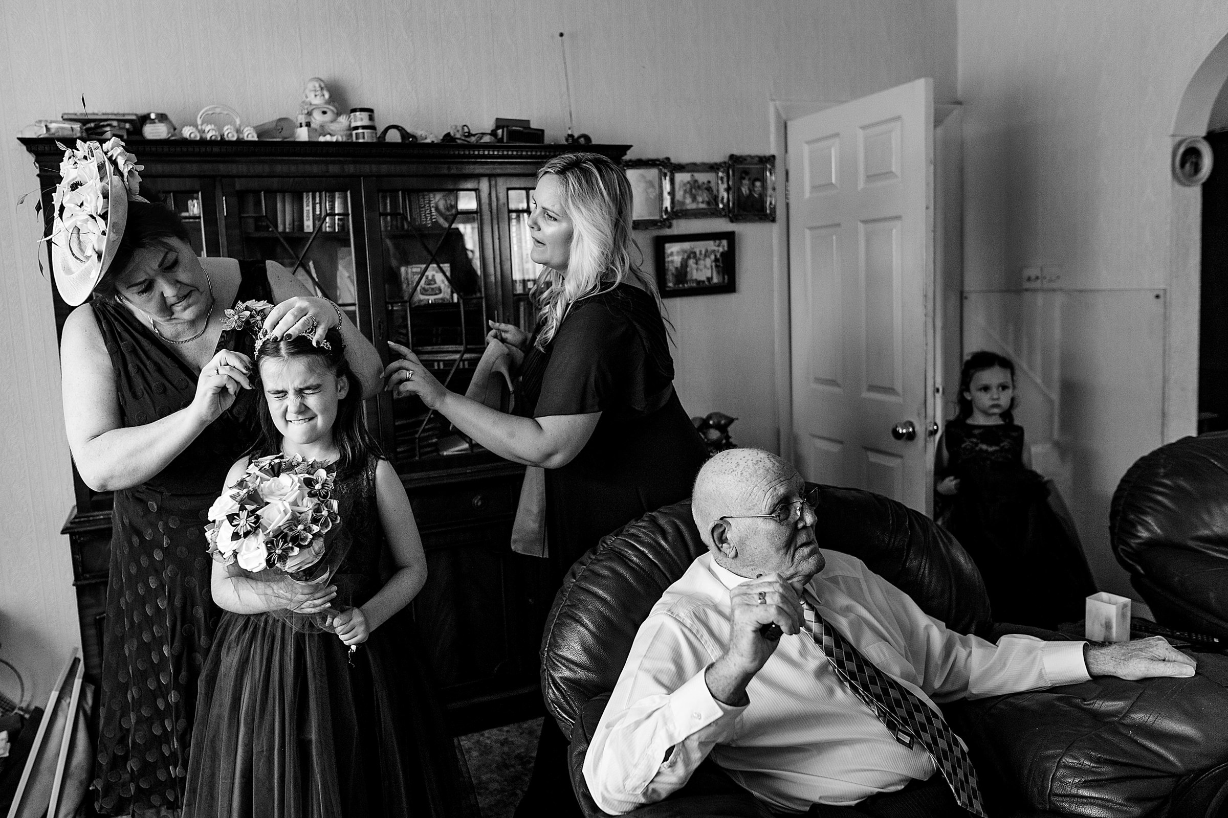 Family getting ready moment - photo by Emma + Rich