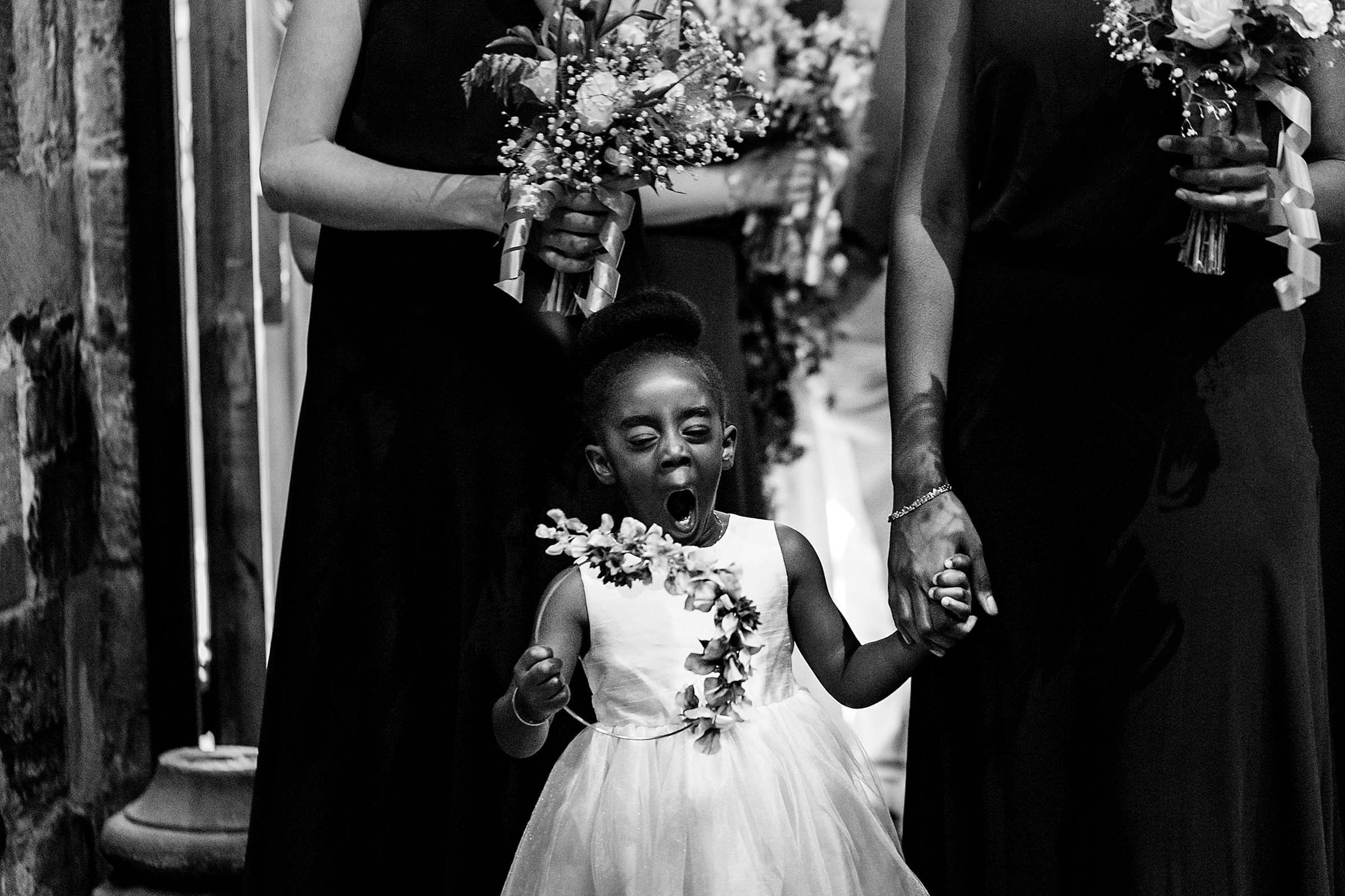 Flower girl yawning - photo by Emma + Rich