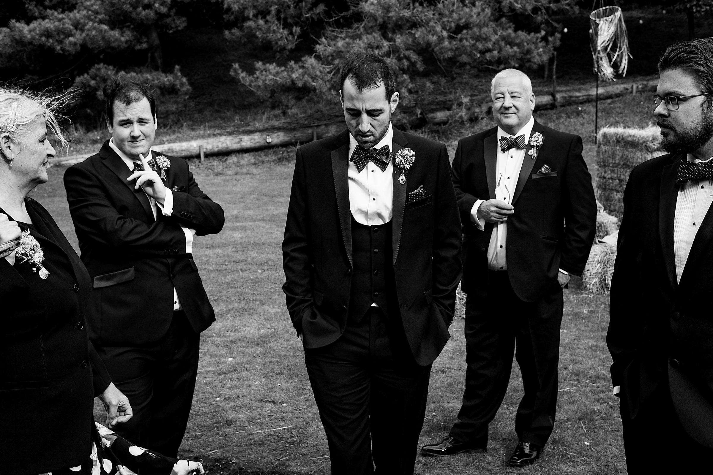 Groom moment with wedding party - photo by Emma + Rich