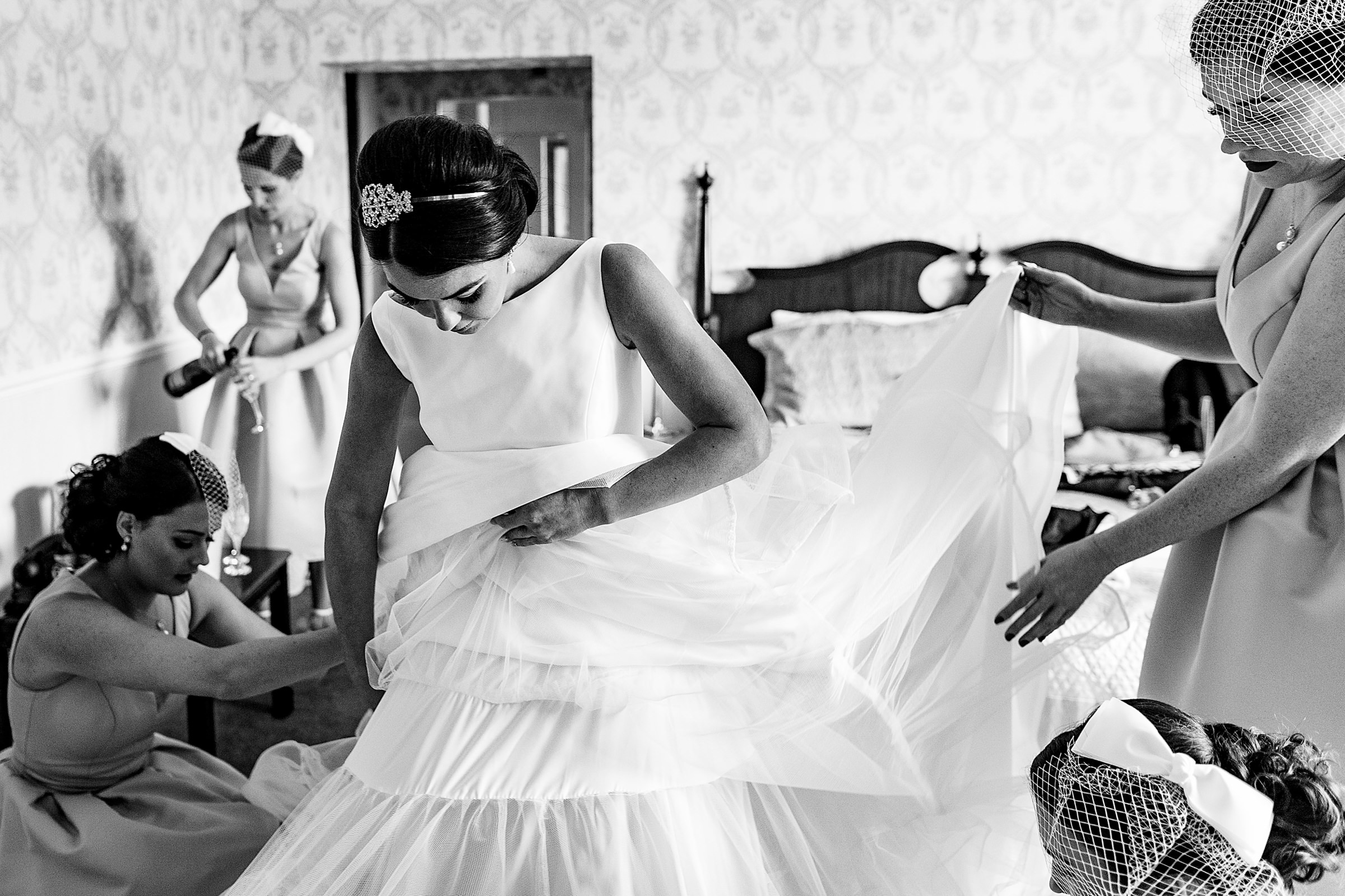 Helping the bride get ready - photo by Emma + Rich