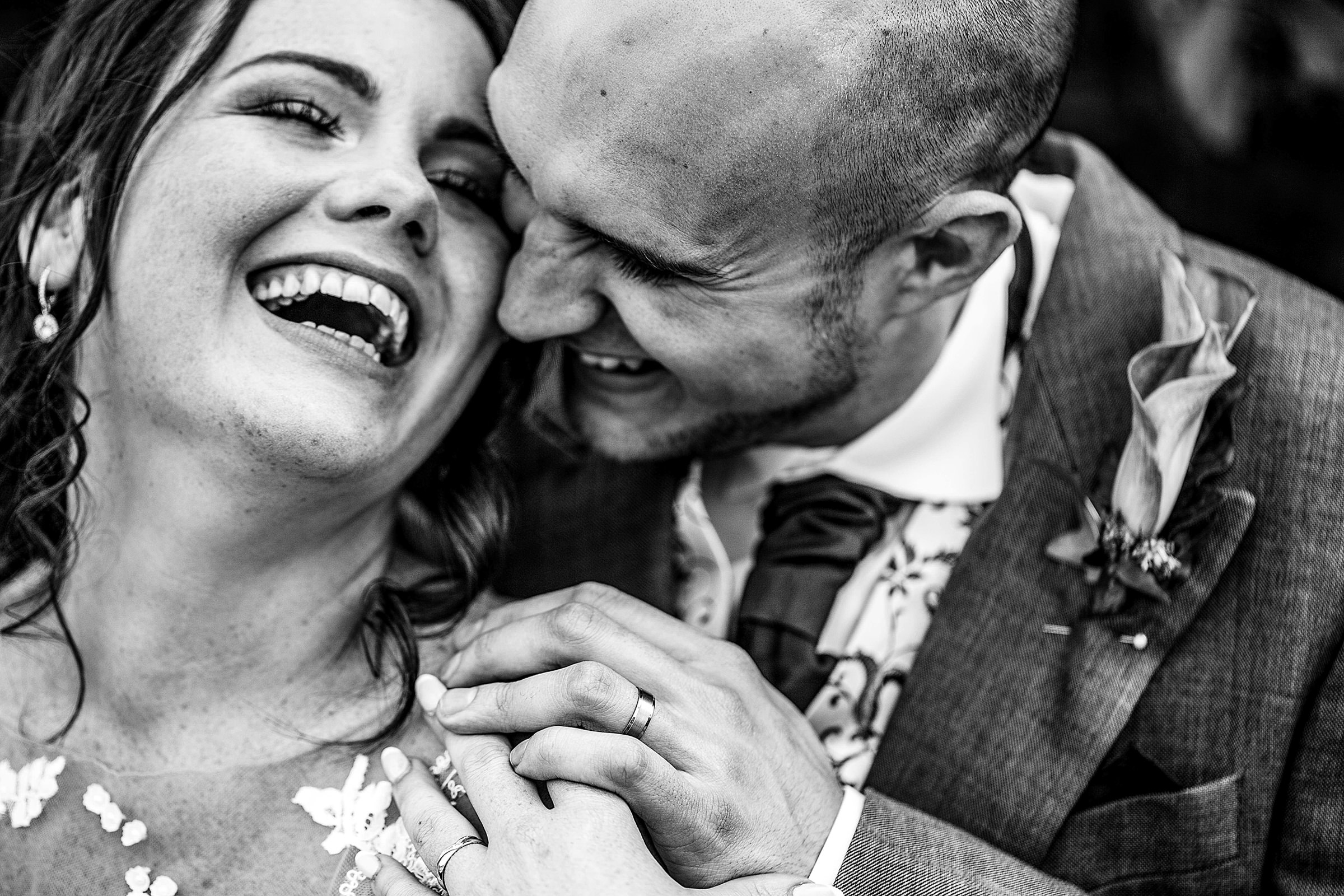 Laughing couple capture - photo by Emma + Rich