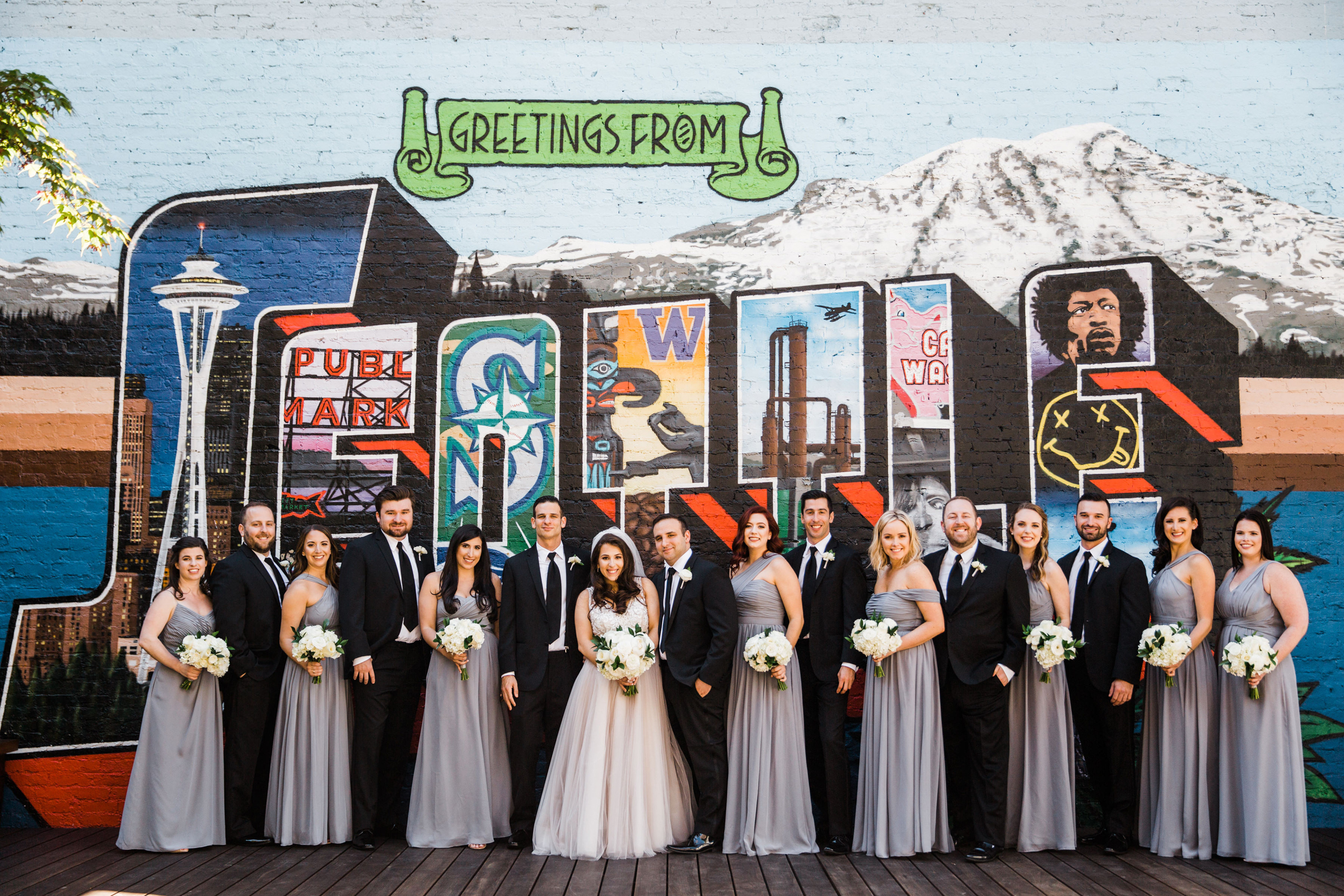 Bridal party wearing lavender gowns at Seattle mural - photo by Stephanie Cristalli Photography
