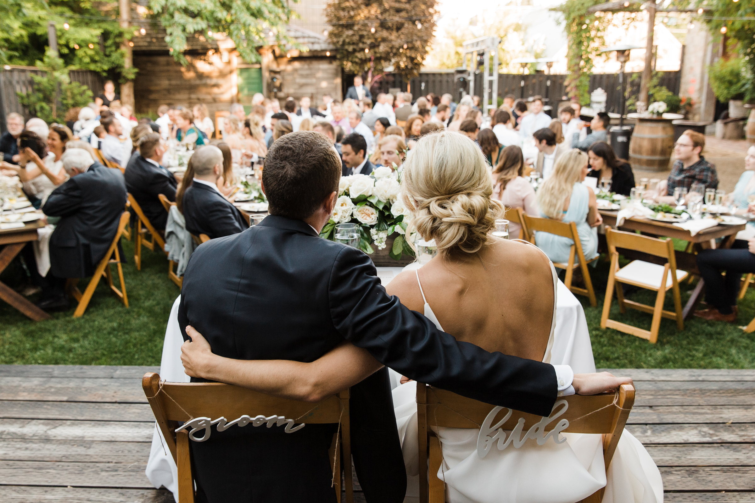 Bride and groom look out at guests - photo by Stephanie Cristalli Photography