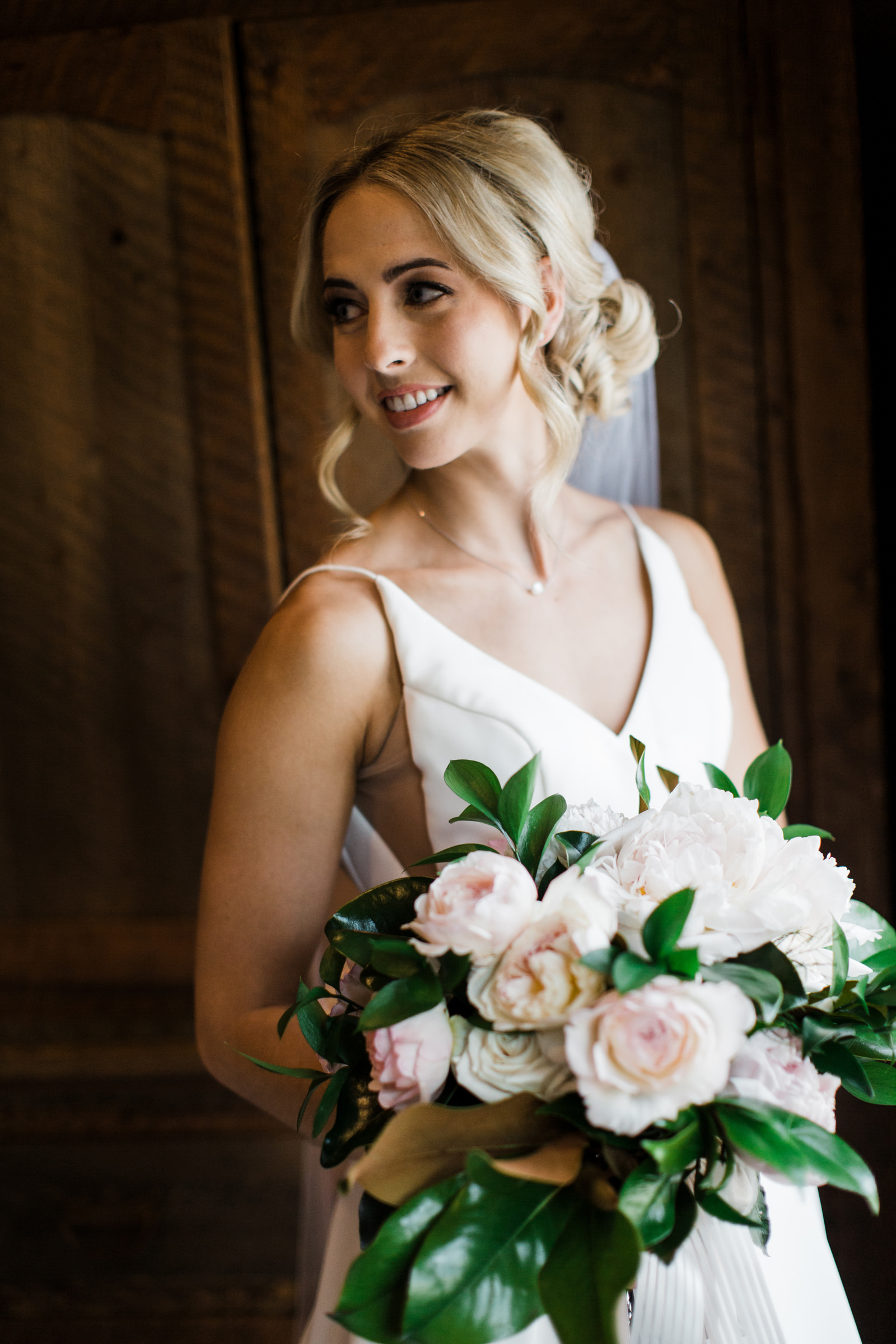 Bride holding large pink peony bouquet - photo by Stephanie Cristalli Photography