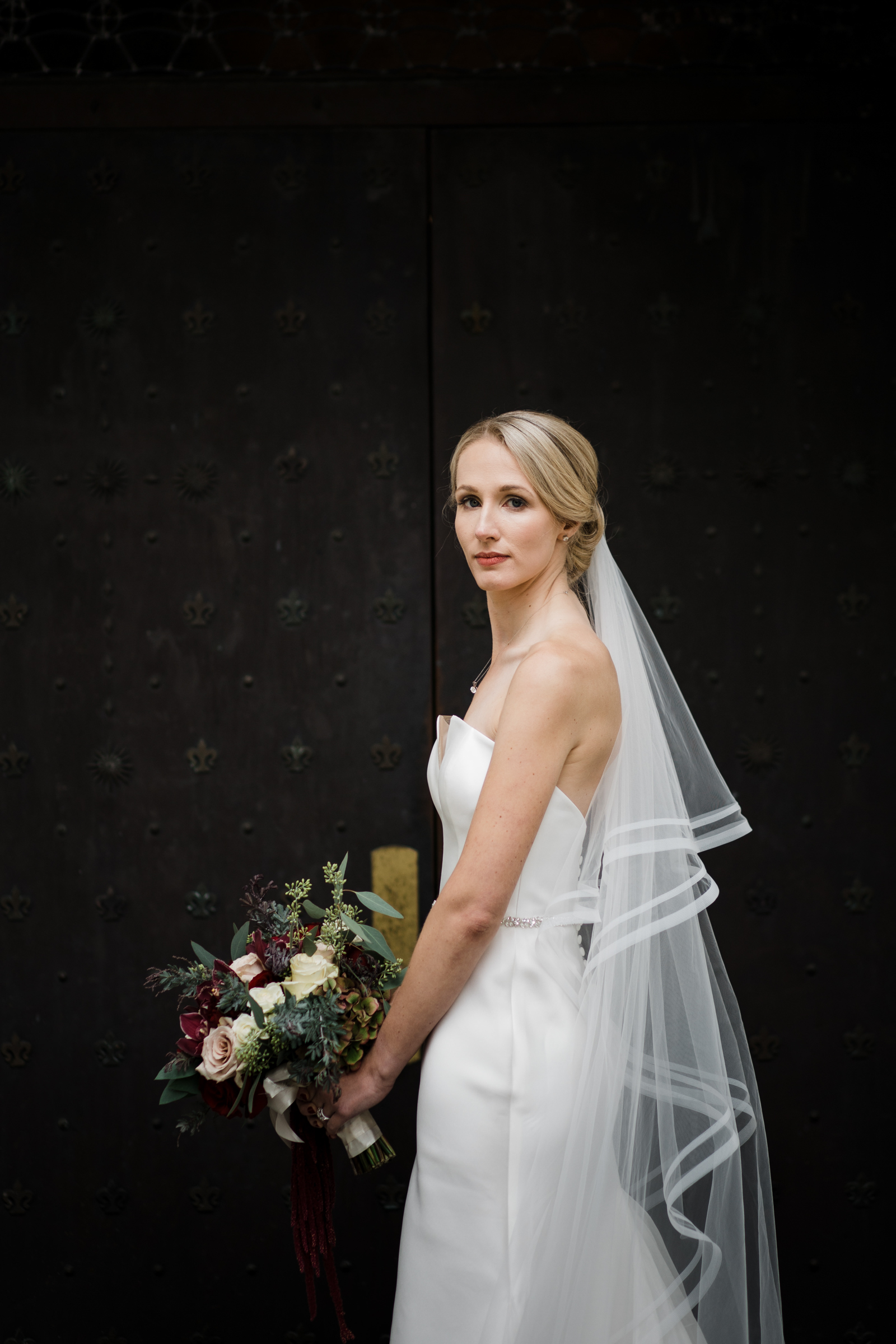Bride in silk strapless gown and long veil - photo by Stephanie Cristalli Photography