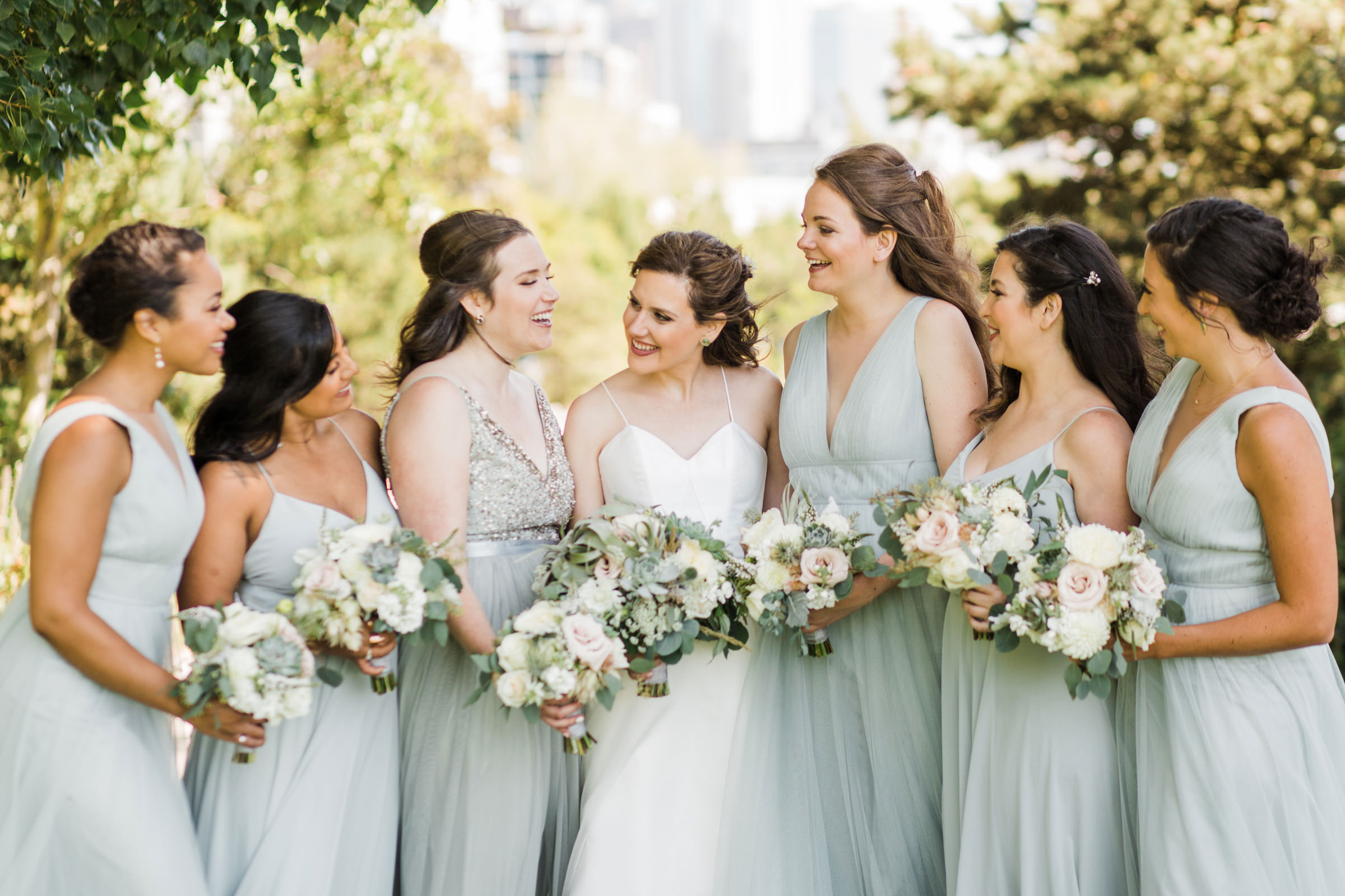 Bride with bridesmaid in powder blue chiffon dresses - photo by Stephanie Cristalli Photography