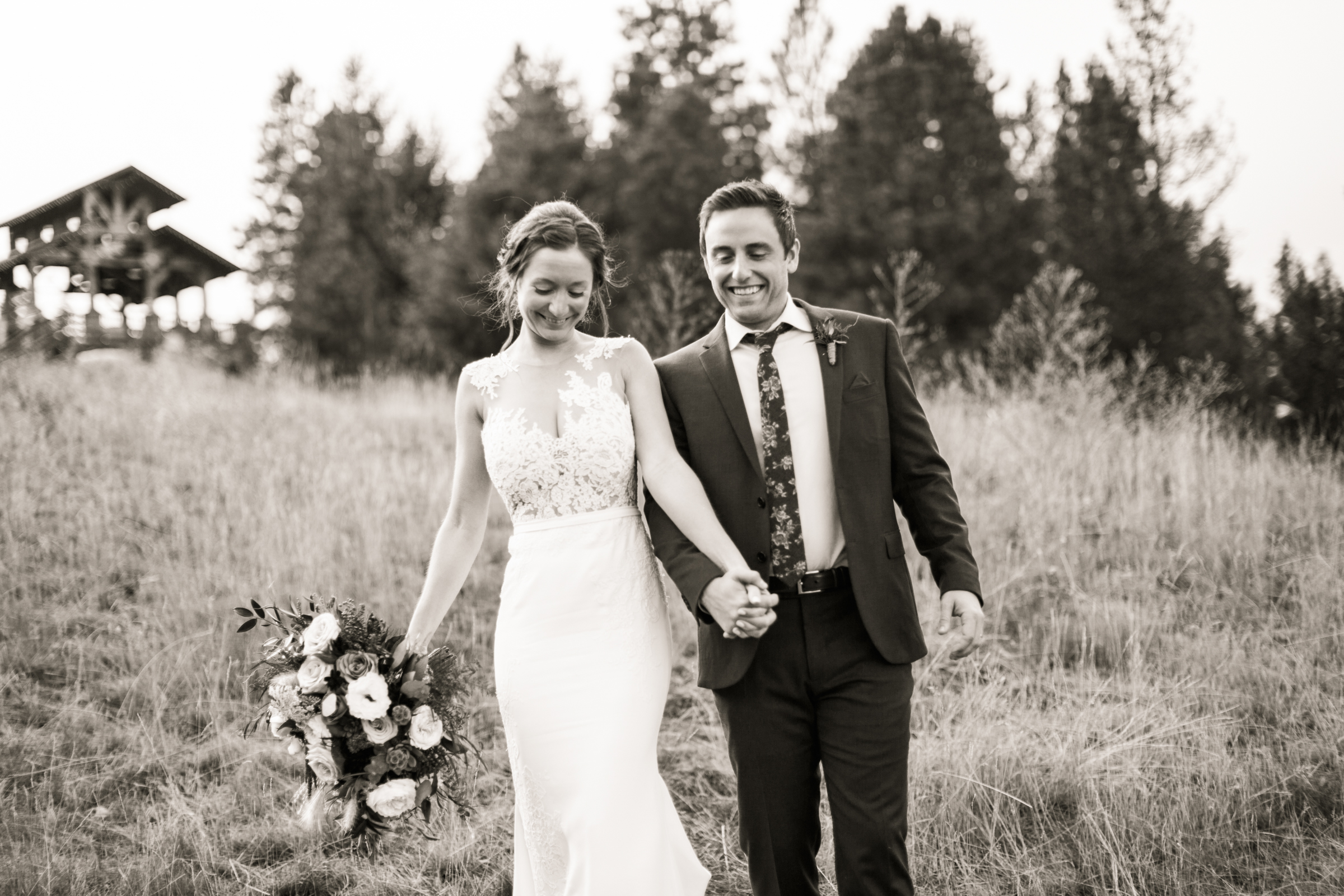 Bride with lace bodice sheath gown holds her grooms hand - photo by Stephanie Cristalli Photography