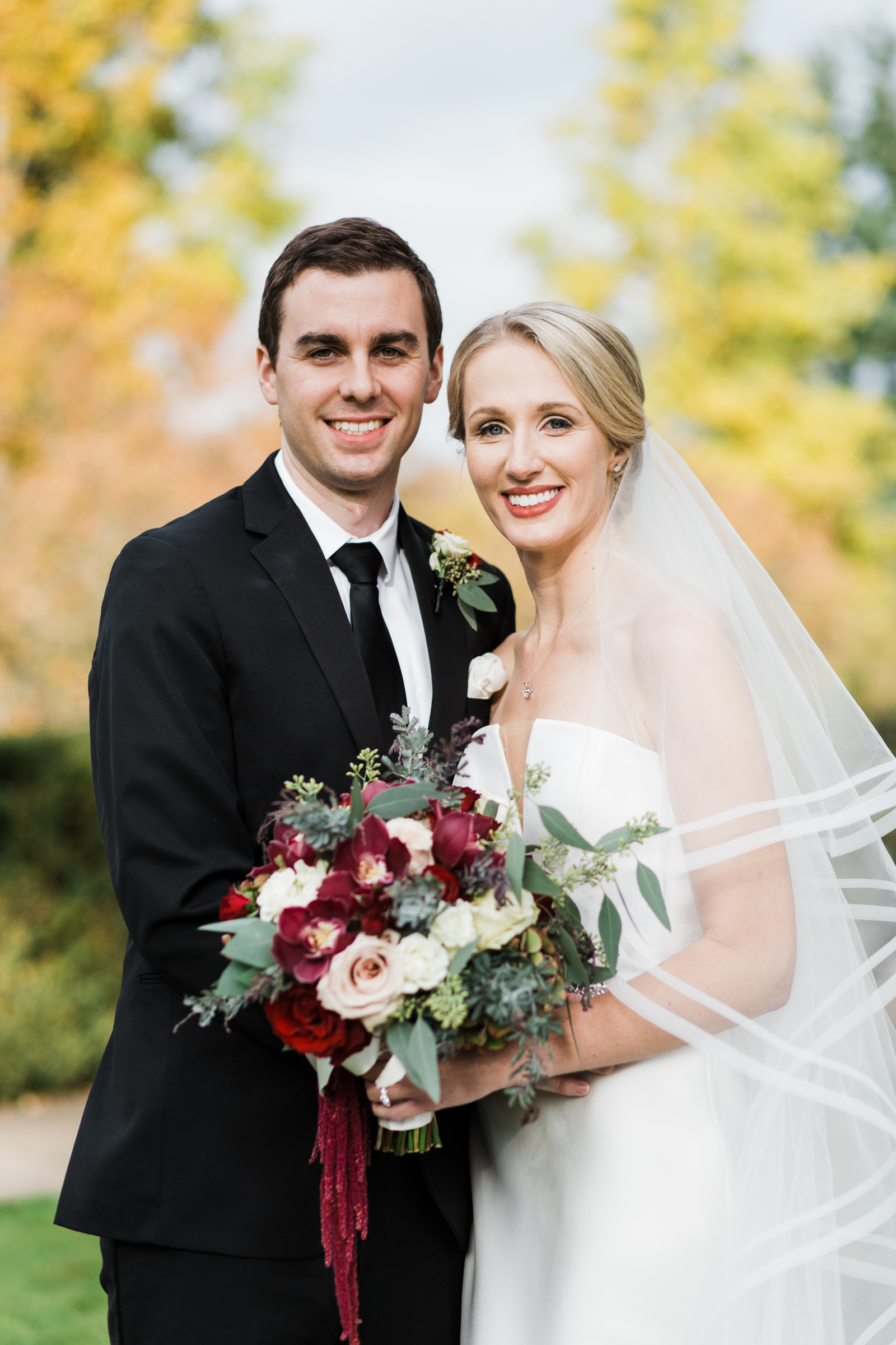 Classic couple portrait with bride holding red rose bouquet - photo by Stephanie Cristalli Photography