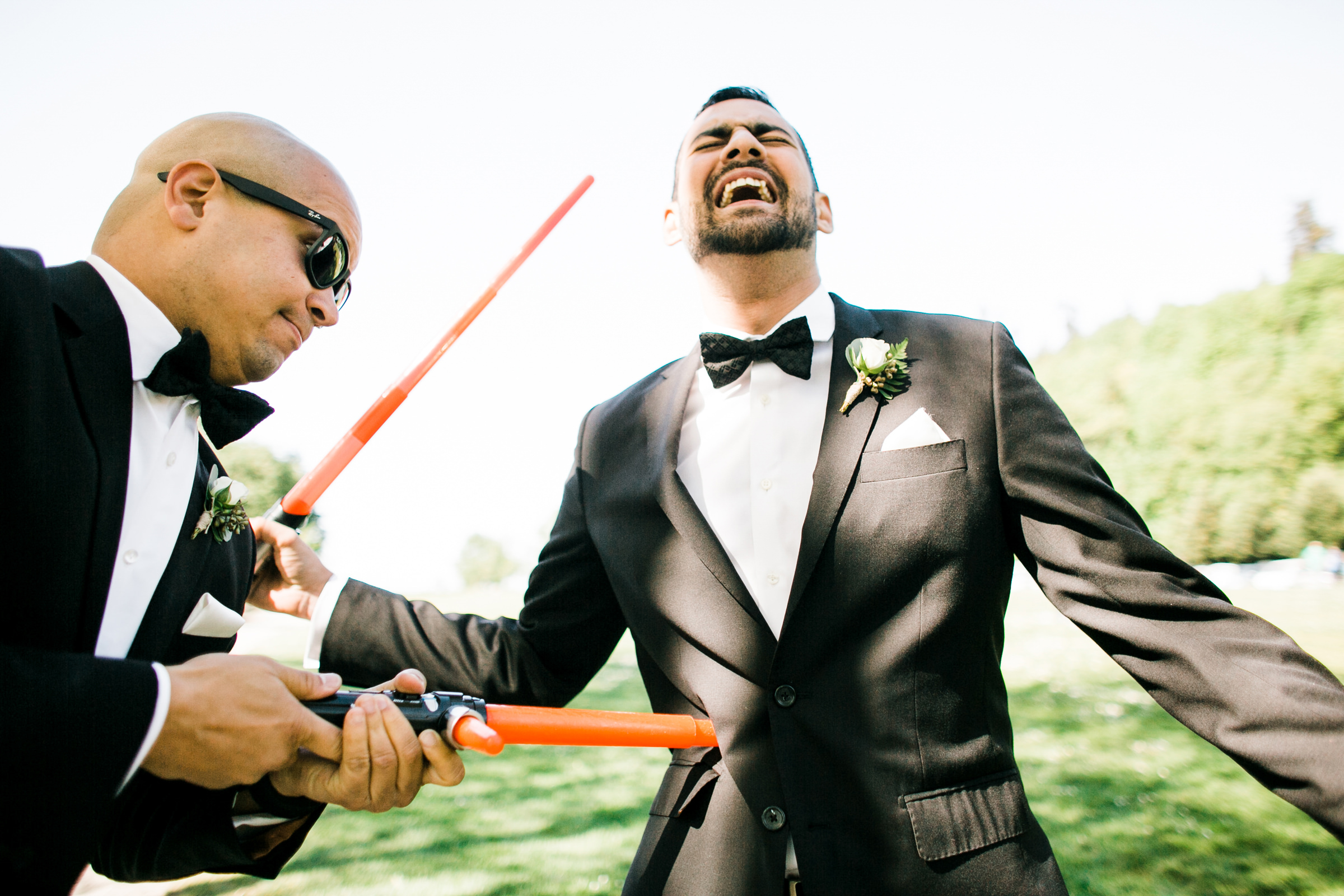 groomsmen stabs groom with toy laser - photo by Stephanie Cristalli Photography