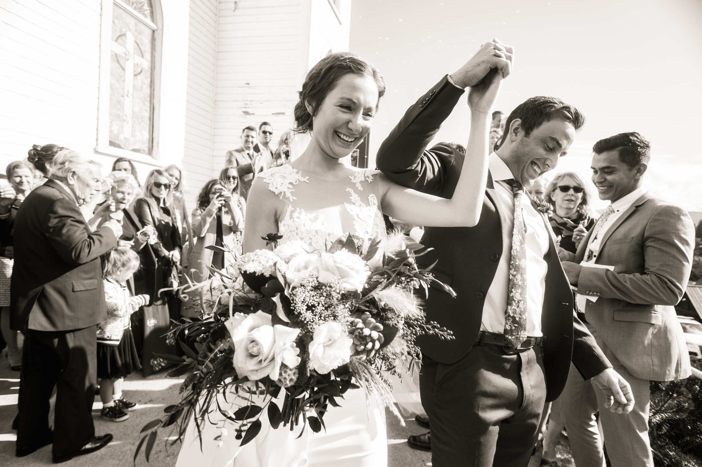 Happy couple celebrate after wedding ceremony - photo by Stephanie Cristalli Photography