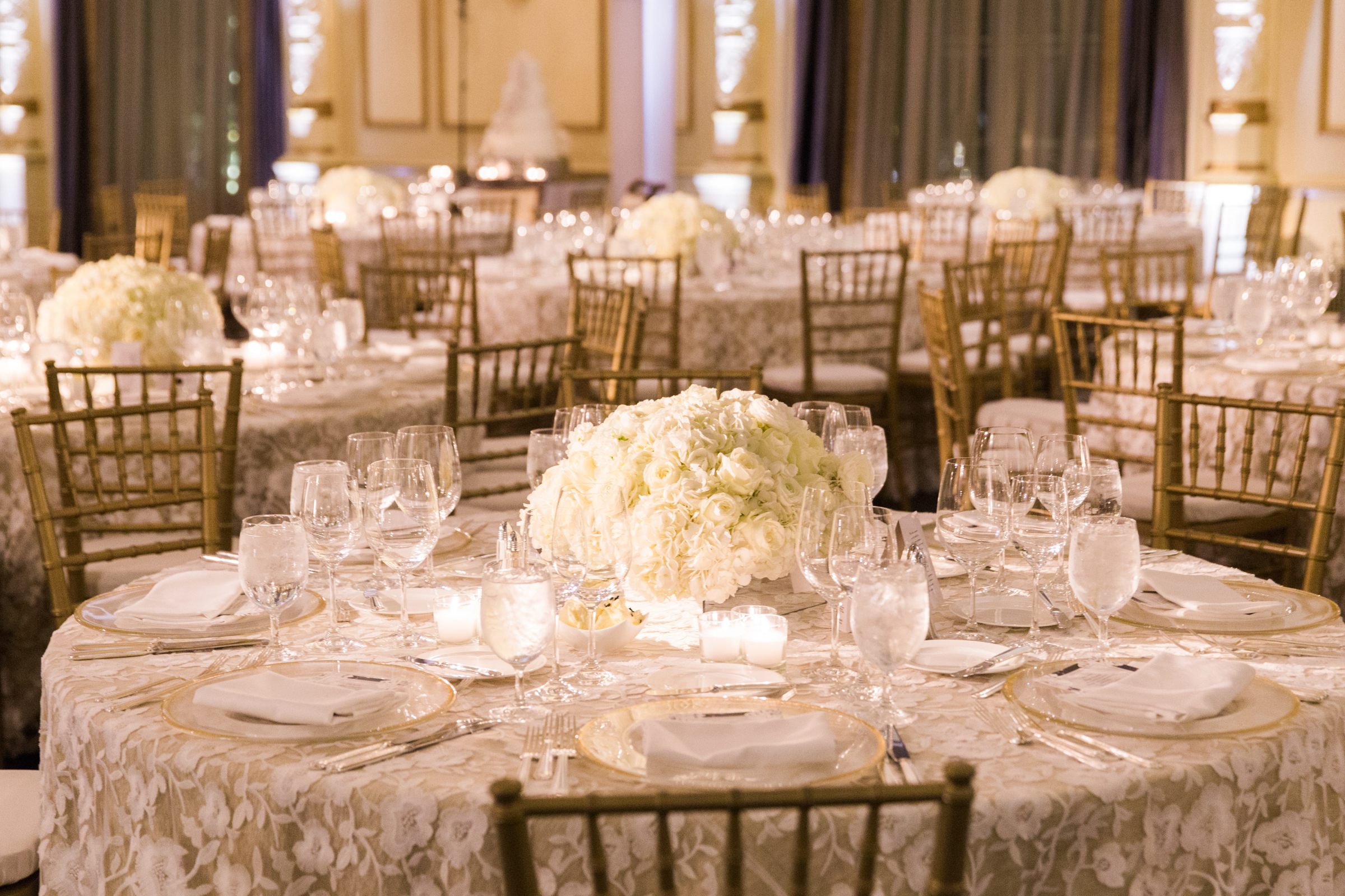 Lace table cloths with gold chivari chairs - photo by Stephanie Cristalli Photography