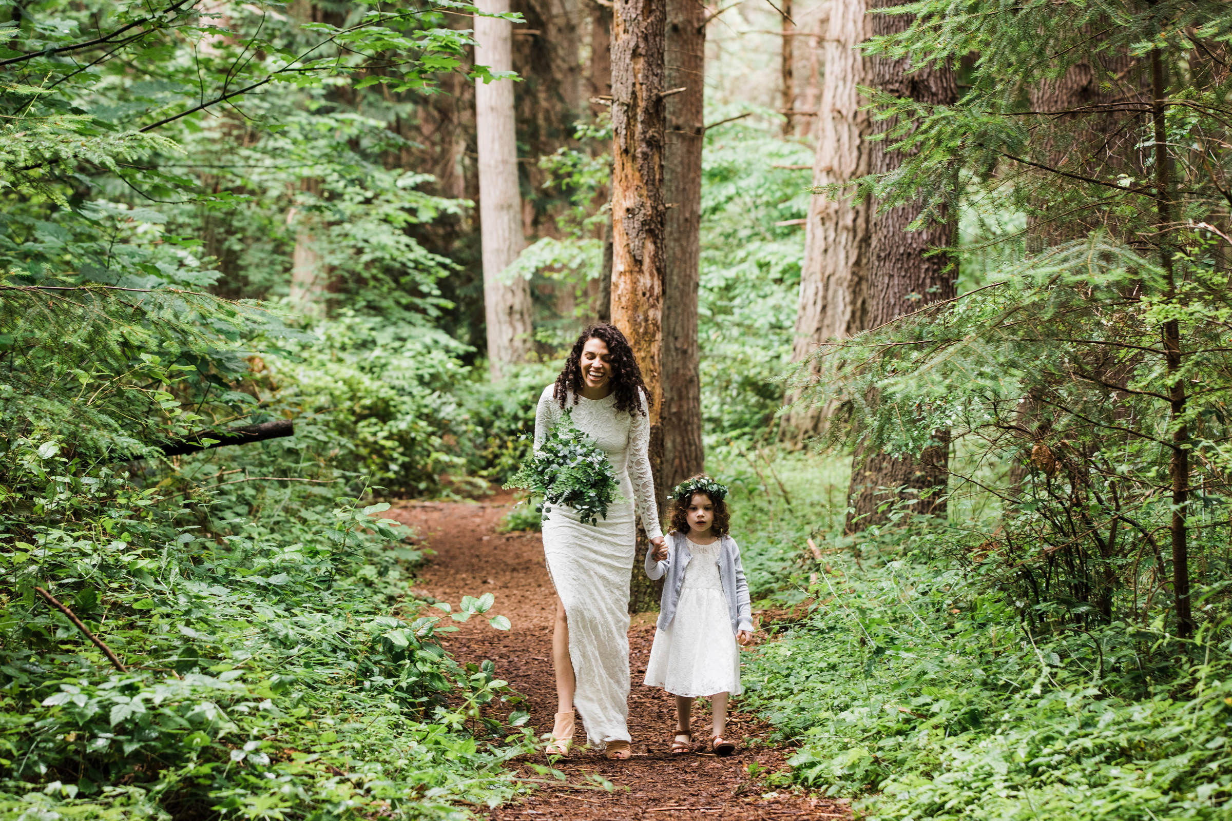 Mom and daughter walk down aisle in the woods - photo by Stephanie Cristalli Photography