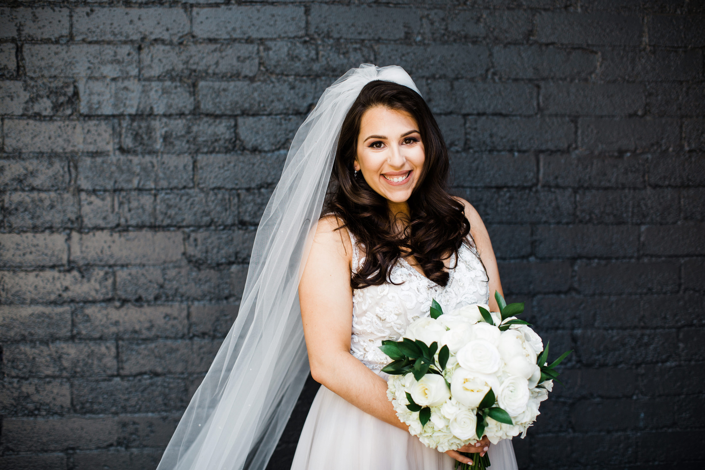 Portrait of bride with white peony bouquet - photo by Stephanie Cristalli Photography