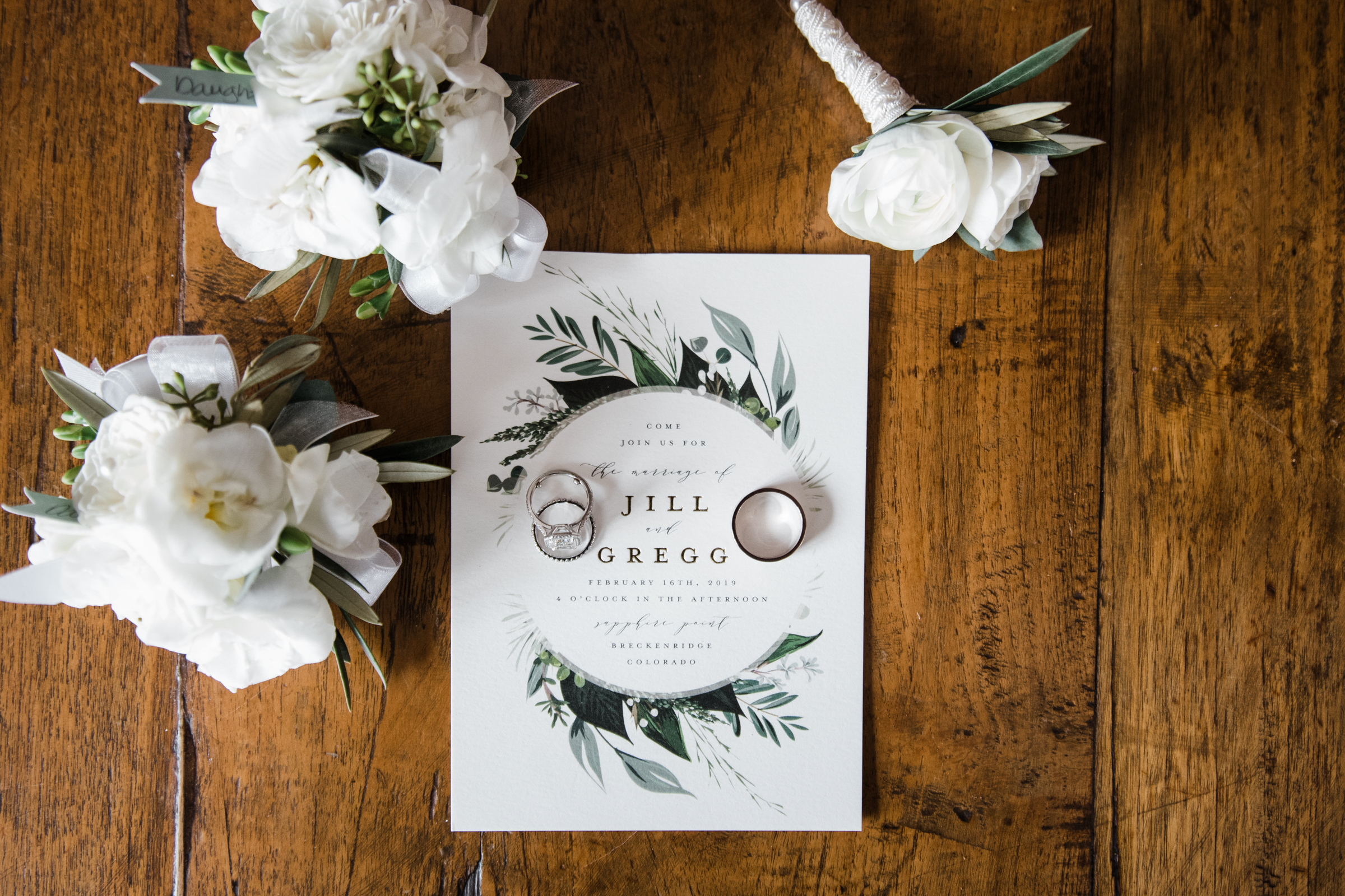 Rings and invitation with round leaf design - photo by Stephanie Cristalli Photography