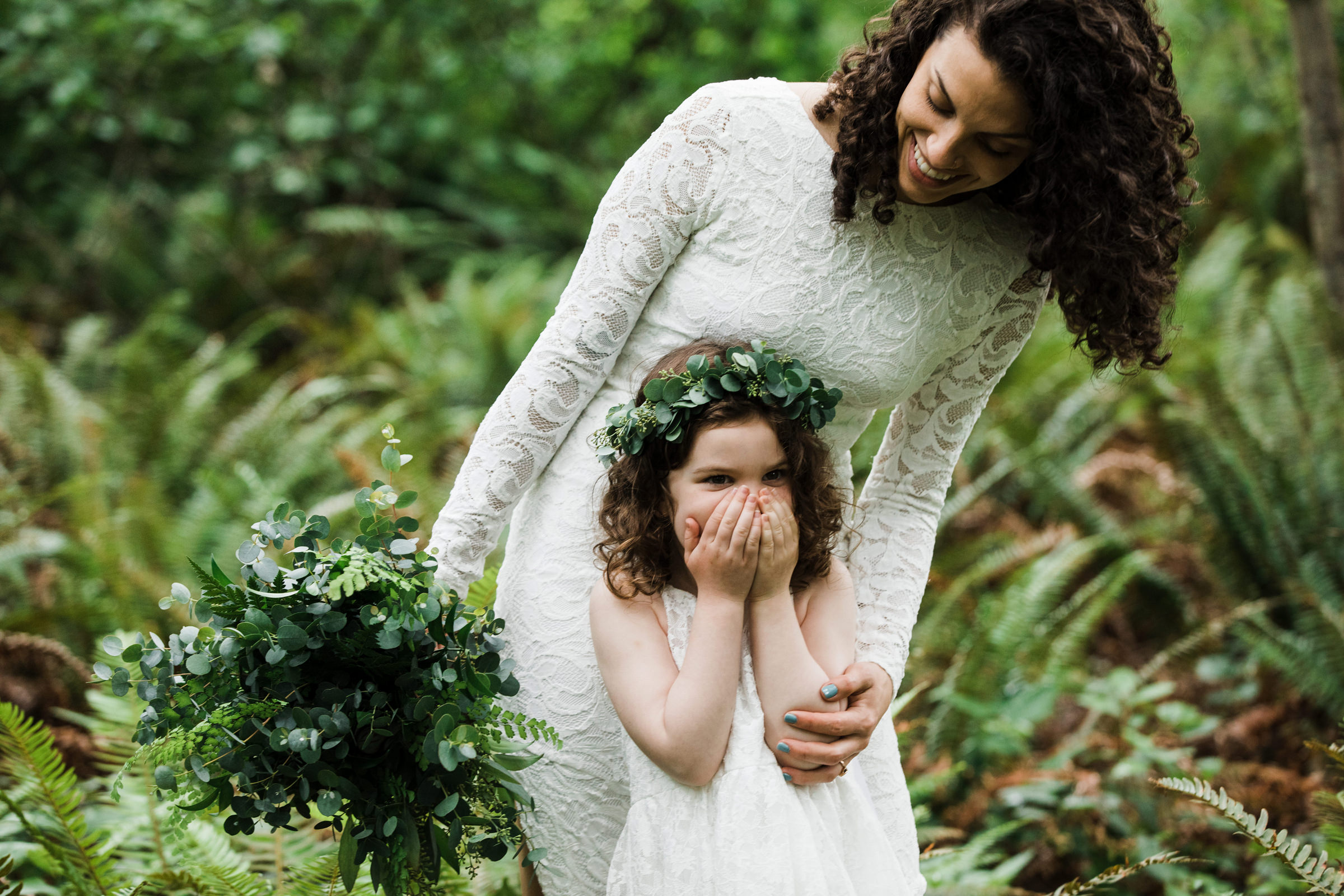 Surprised little girl wearing eucalyptus crown- photo by Stephanie Cristalli Photography