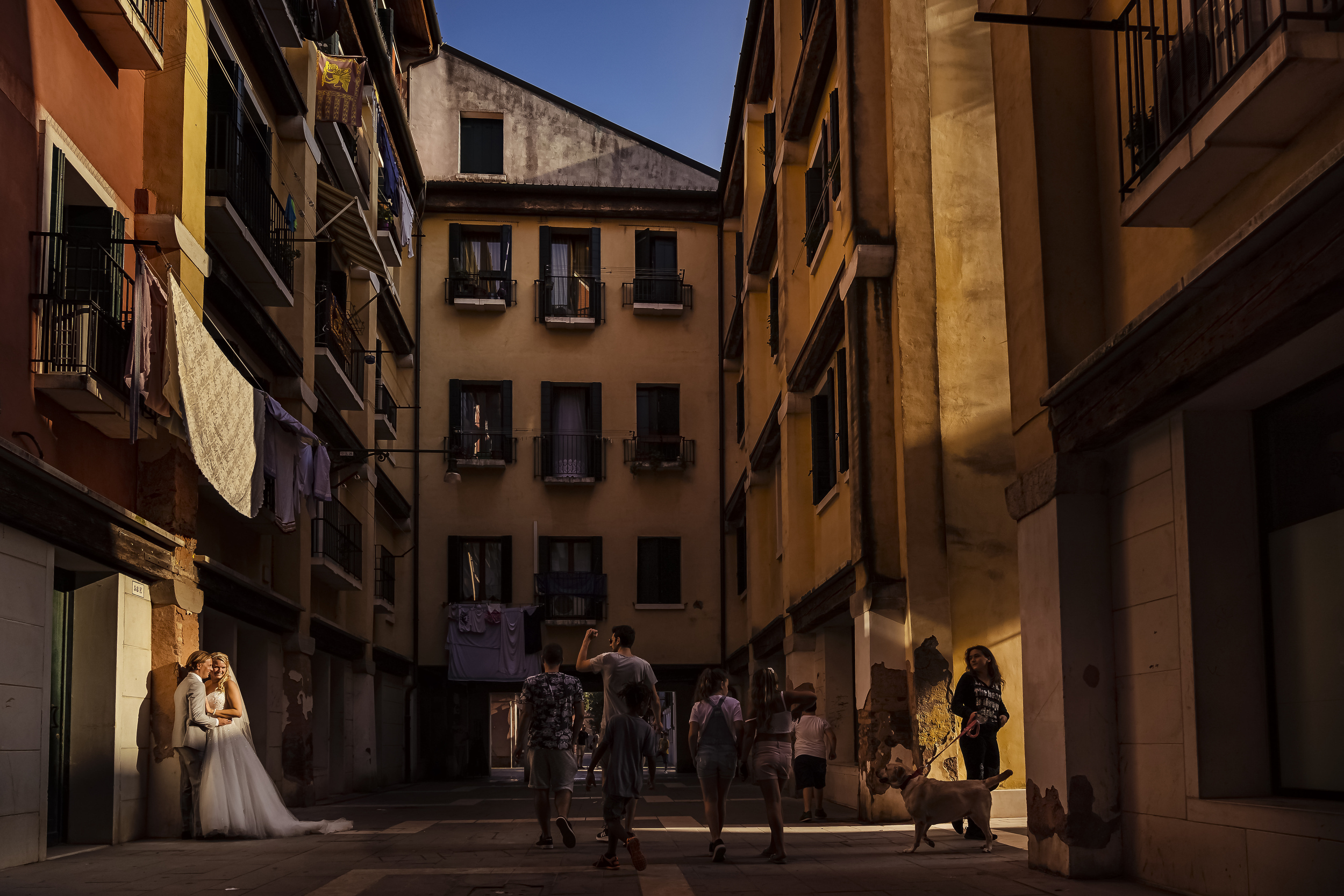 Artistic european street scene with bride and groom - photo by Studio Damon Photograpy