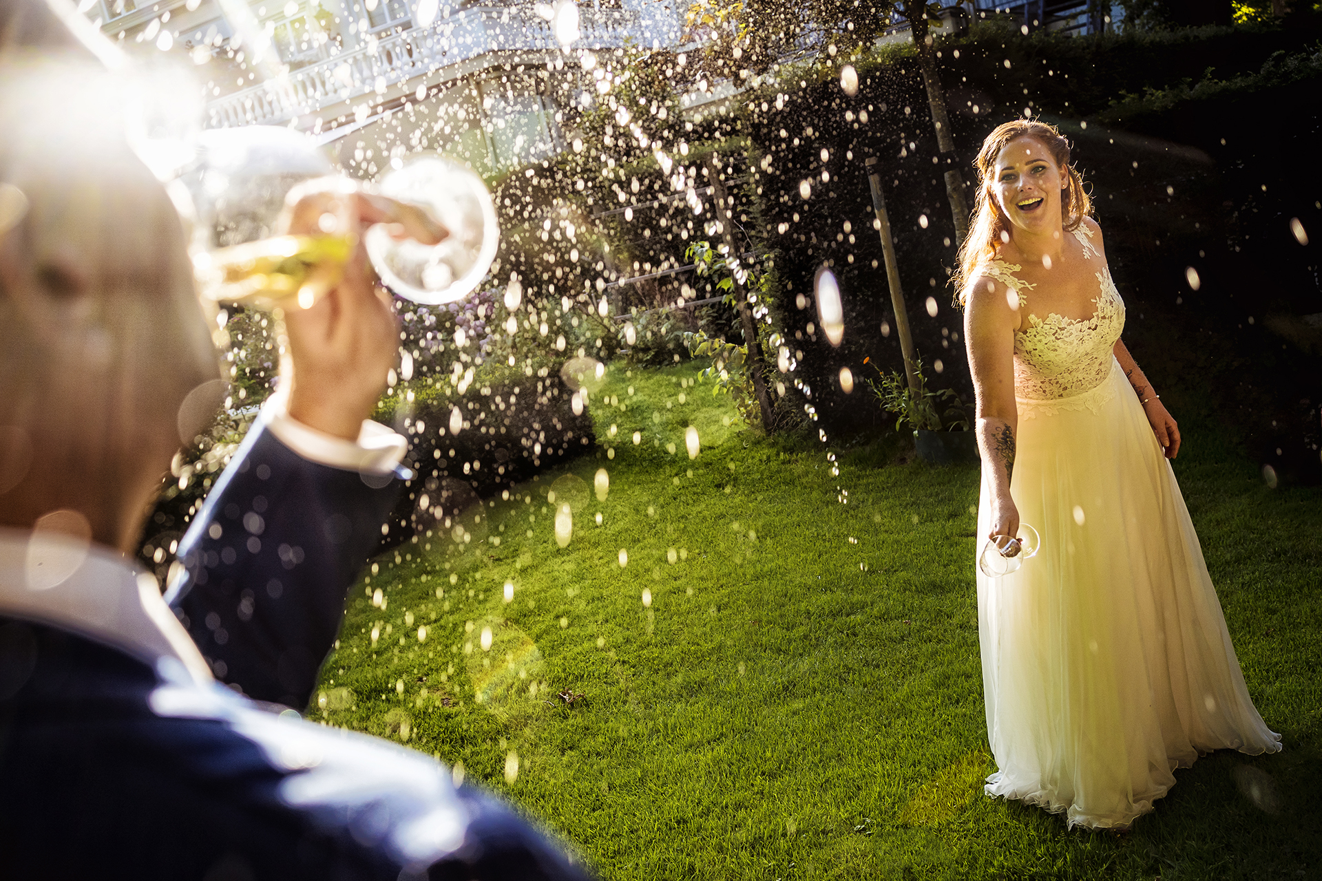 Bride with bubbles in garden - photo by Studio Damon Photograpy