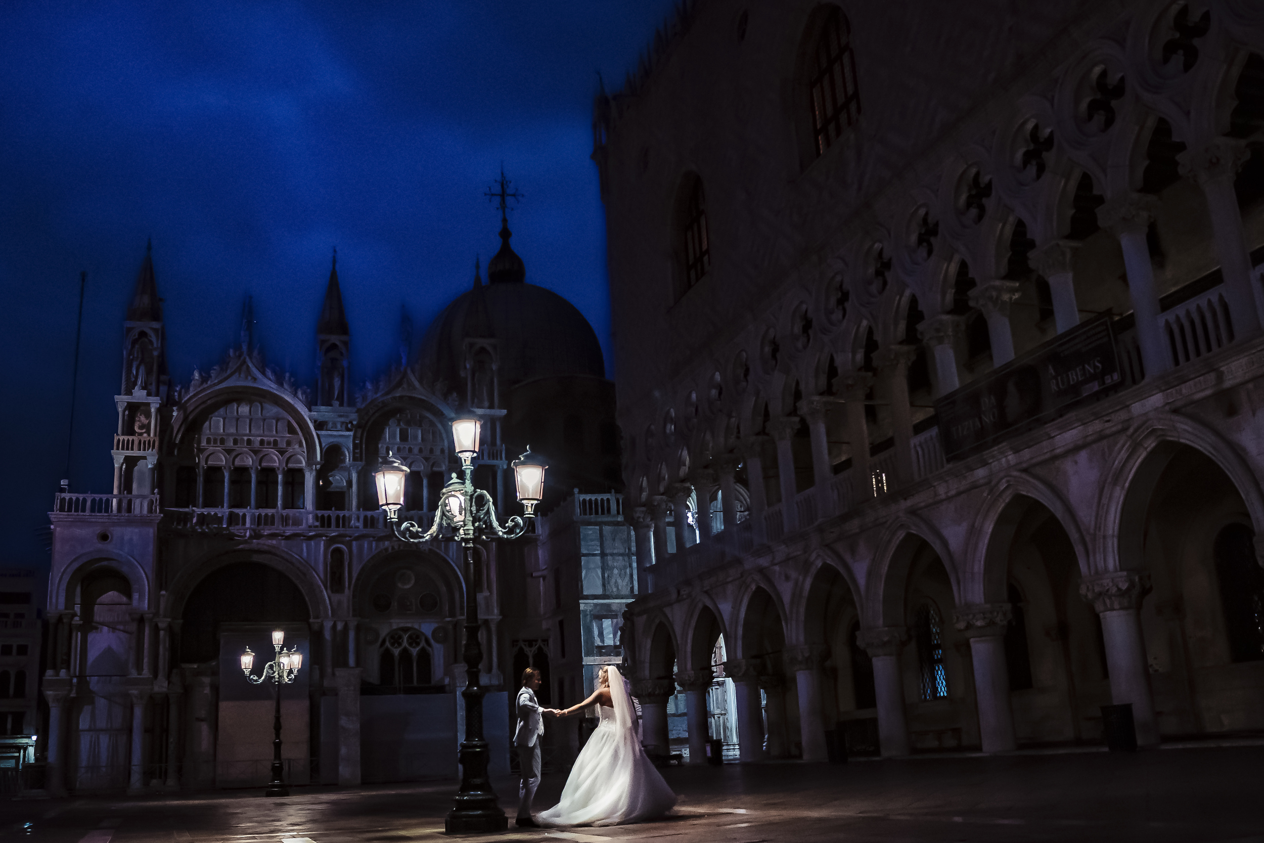Couple in colonnaded plaza at night - photo by Studio Damon Photograpy