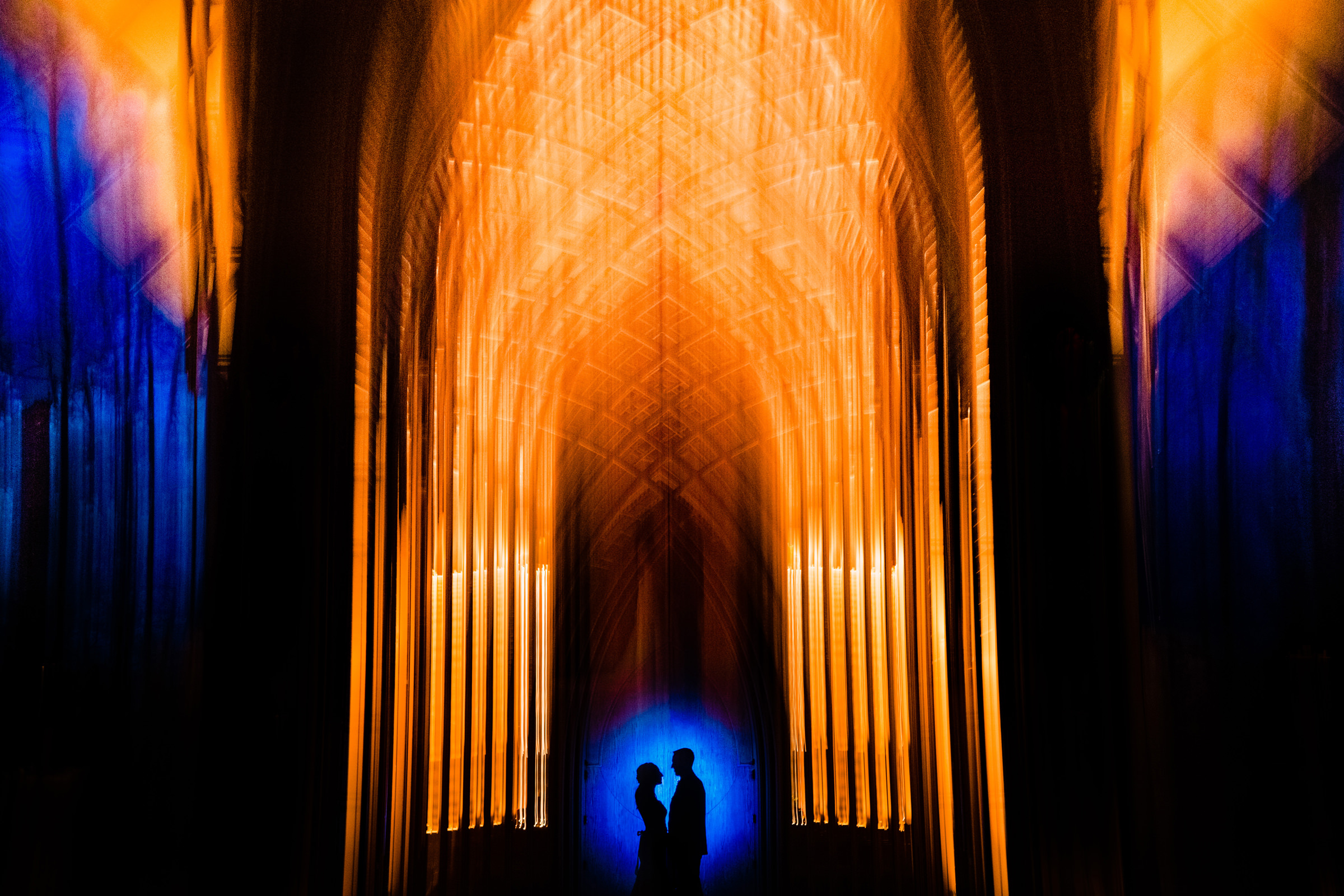 bride and groom colorful silhouette in their church-Arkansas photographer- photo by Vinson Images