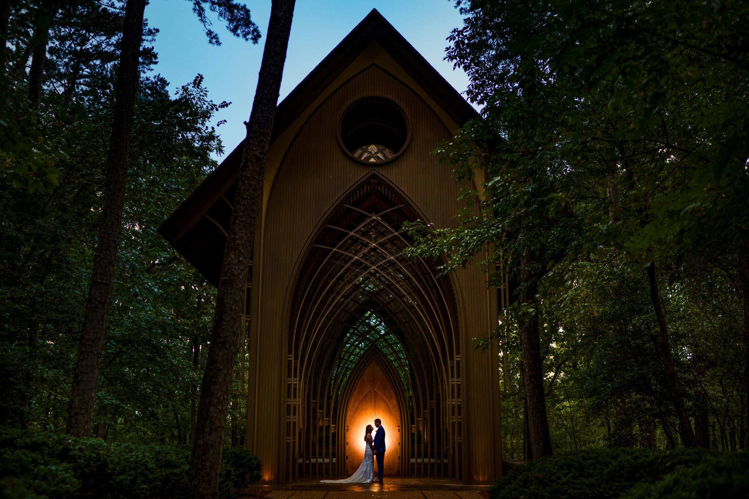bride and groom silhouette shadowed by the forest-Arkansas photographer- photo by Vinson Images