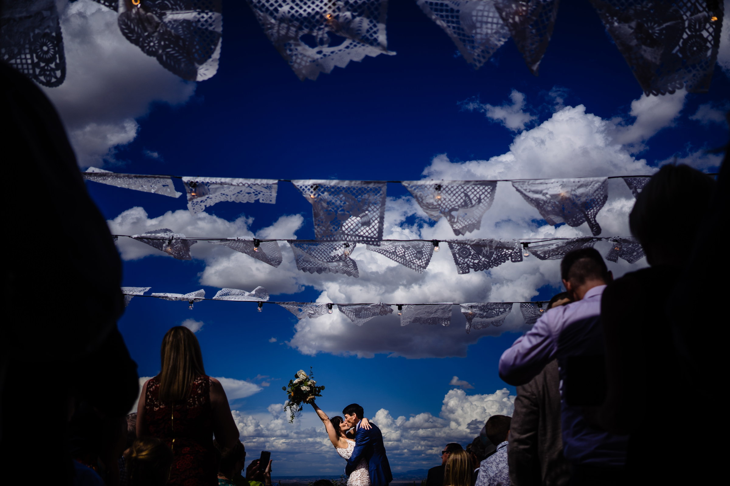 bride and grooms excited first kiss amongst the clouds-Arkansas photographer- photo by Vinson Images