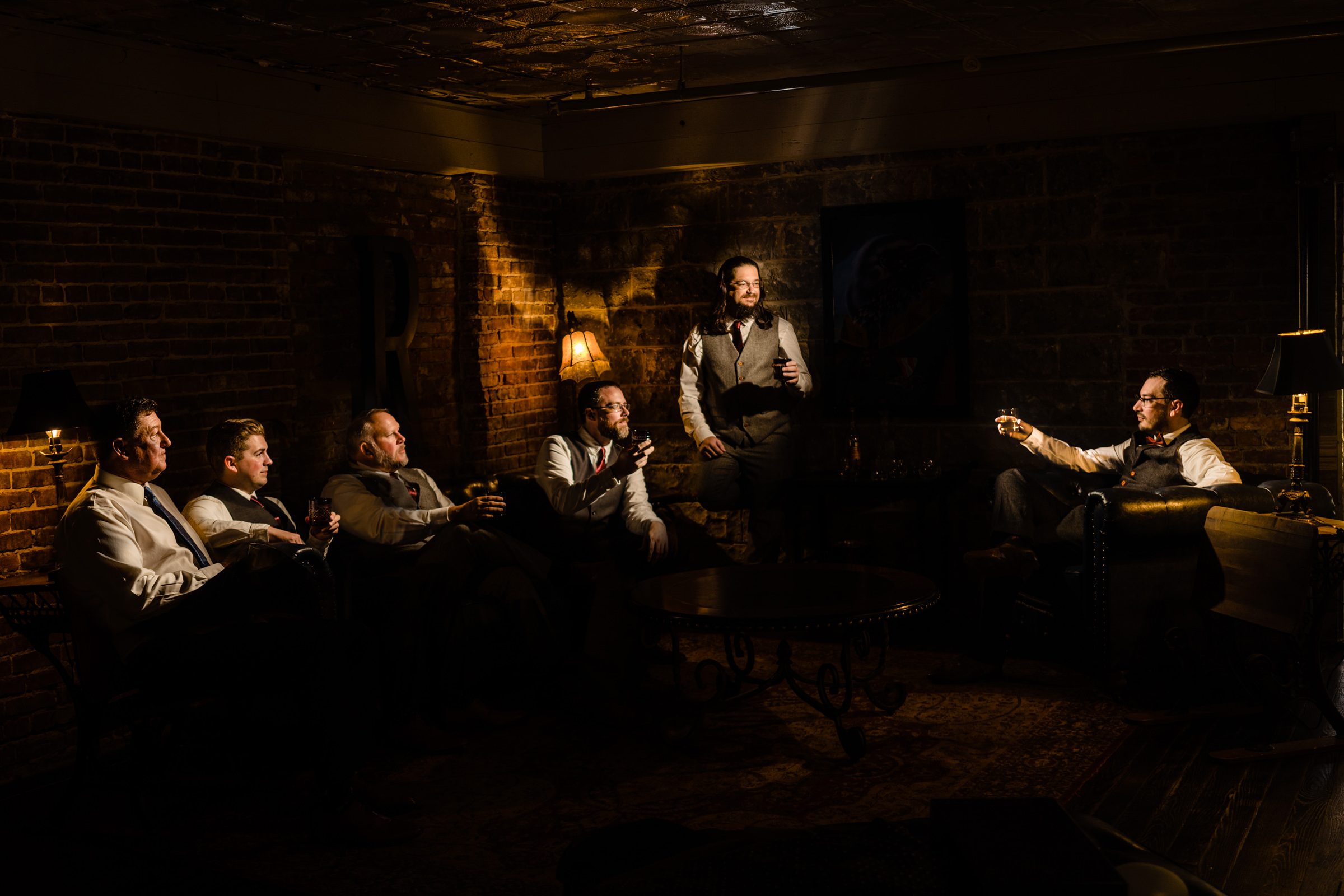 groom and groomsmen hanging together in brick room-Arkansas photographer- photo by Vinson Images