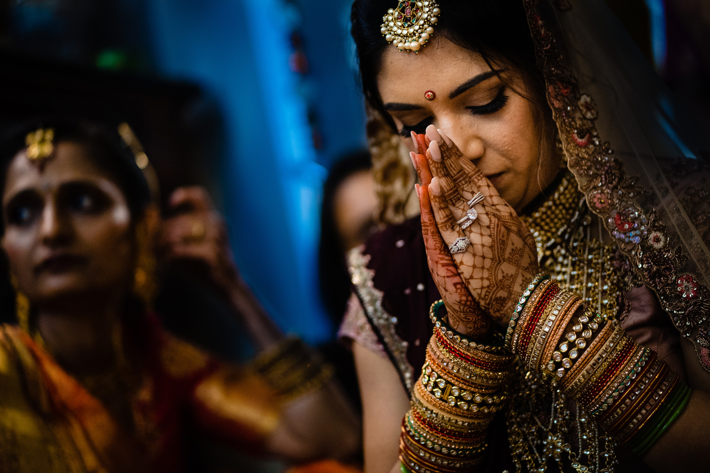 indian bride praying with beautiful henna tattoos on her hands-Arkansas photographer- photo by Vinson Images