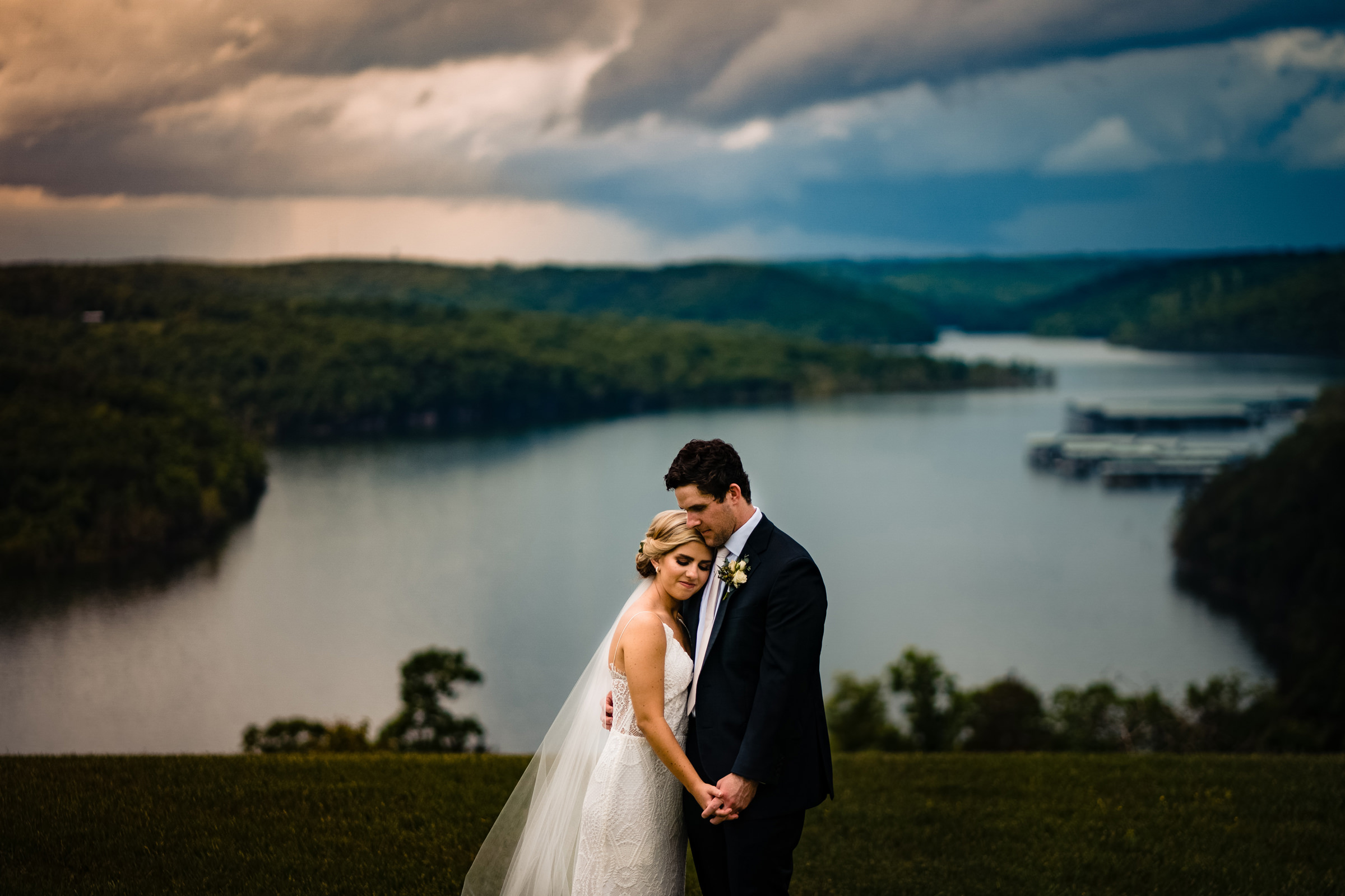 Couple portrait against scenic waterway - photo by Vinson Images