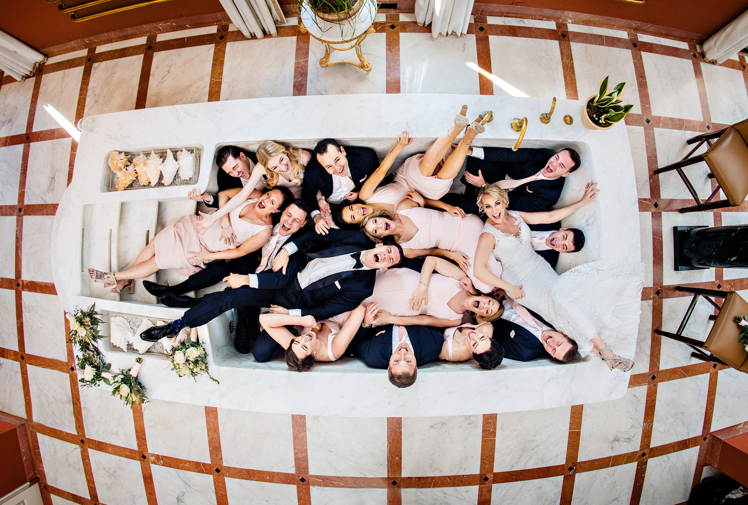 Aerial view of bridal party in luxury bathtub - photo by Jeff Tisman Photography