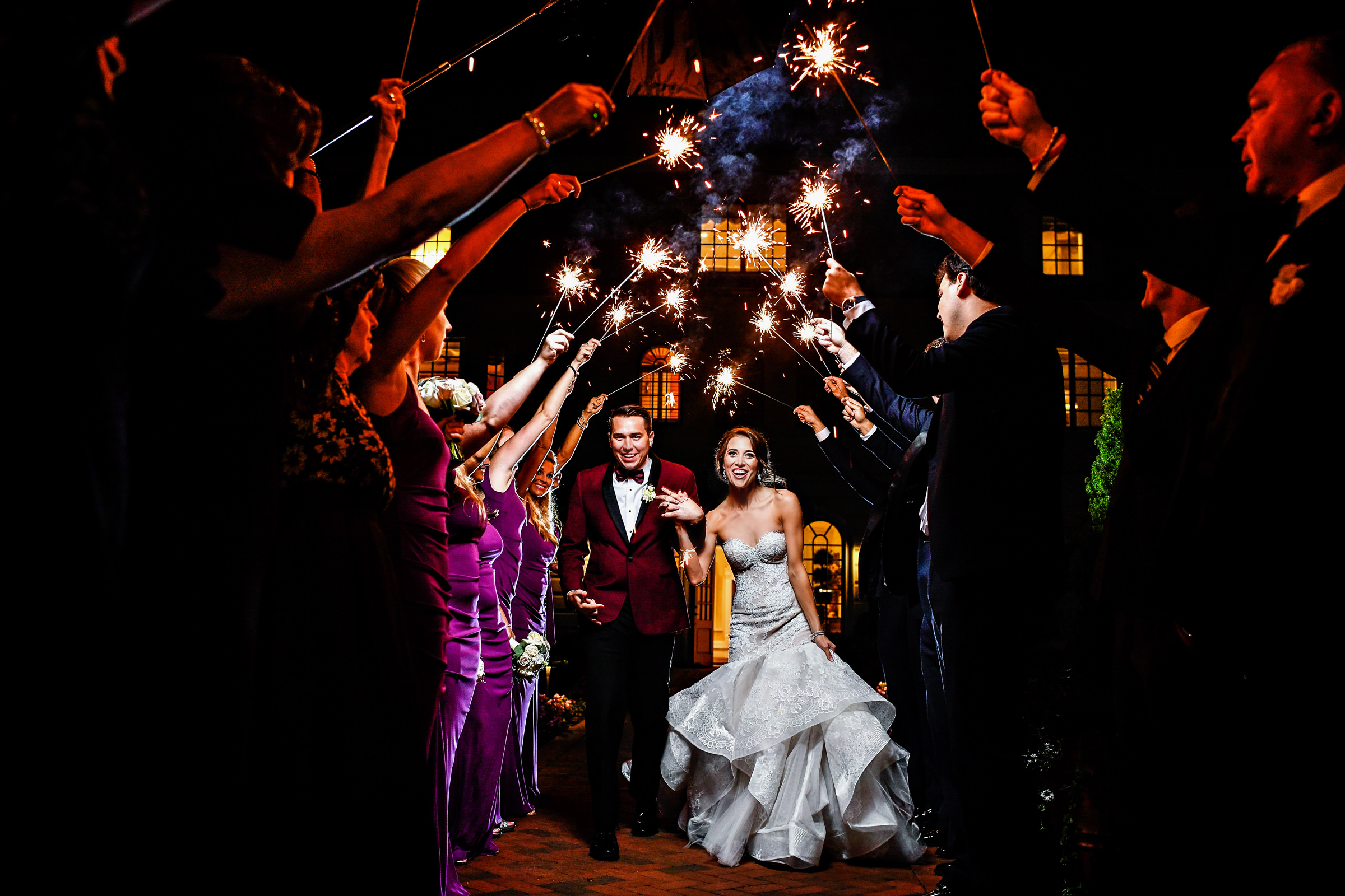Bride and groom exit under a arch of sparklers - photo by Jeff Tisman Photography, New York
