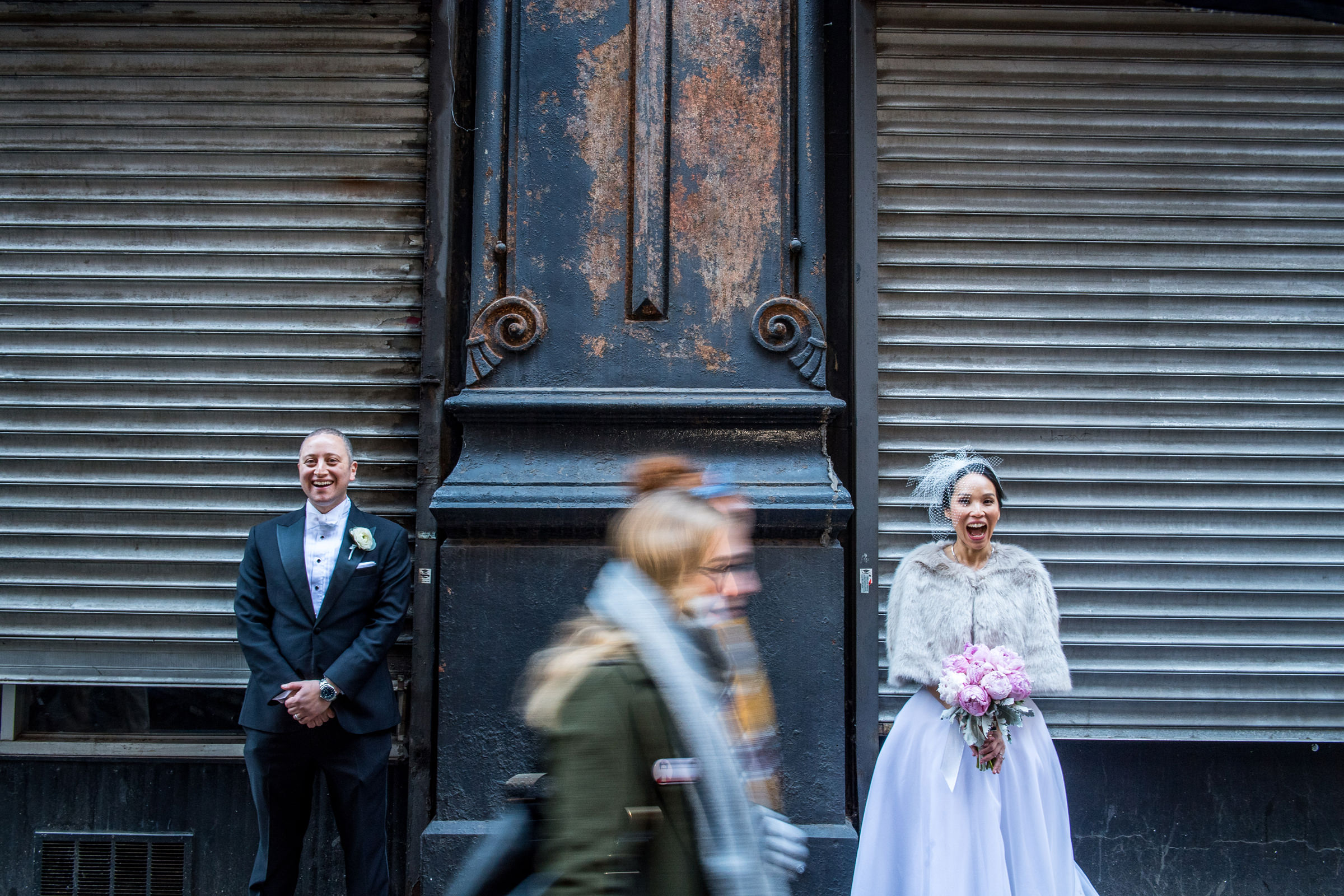 Bride and groom portrait with passerby - photo by Jeff Tisman Photography